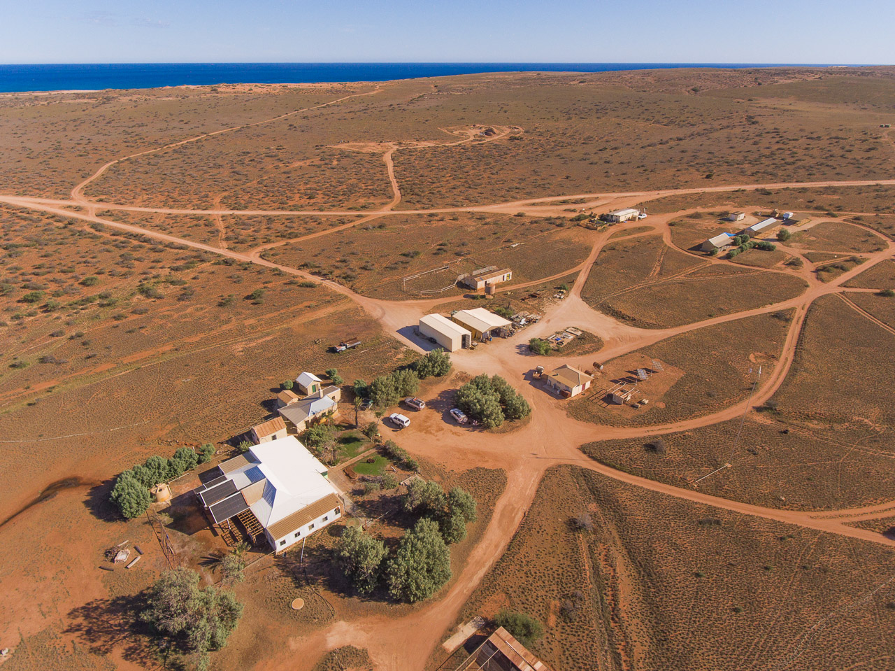 Aerial photo of the homestead and station buildings, looking towards the west coast at Warroora Station in Western Australia