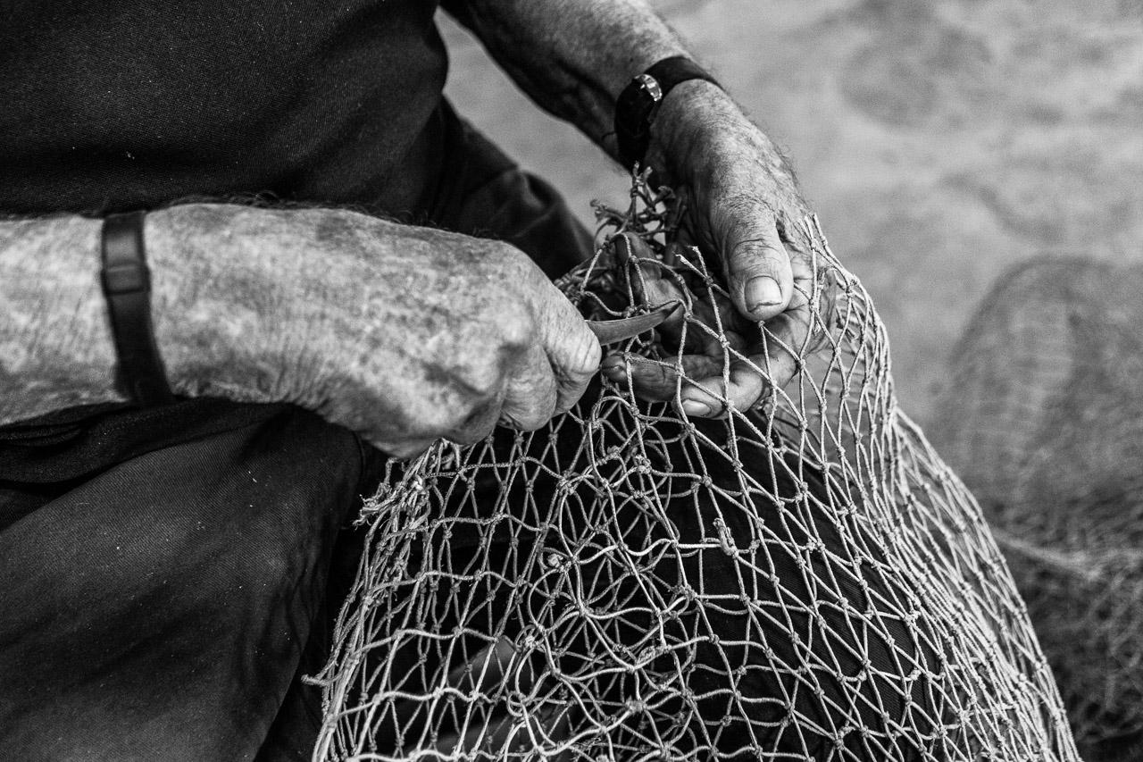 Mending holes in prawn nets at Exmouth Prawns
