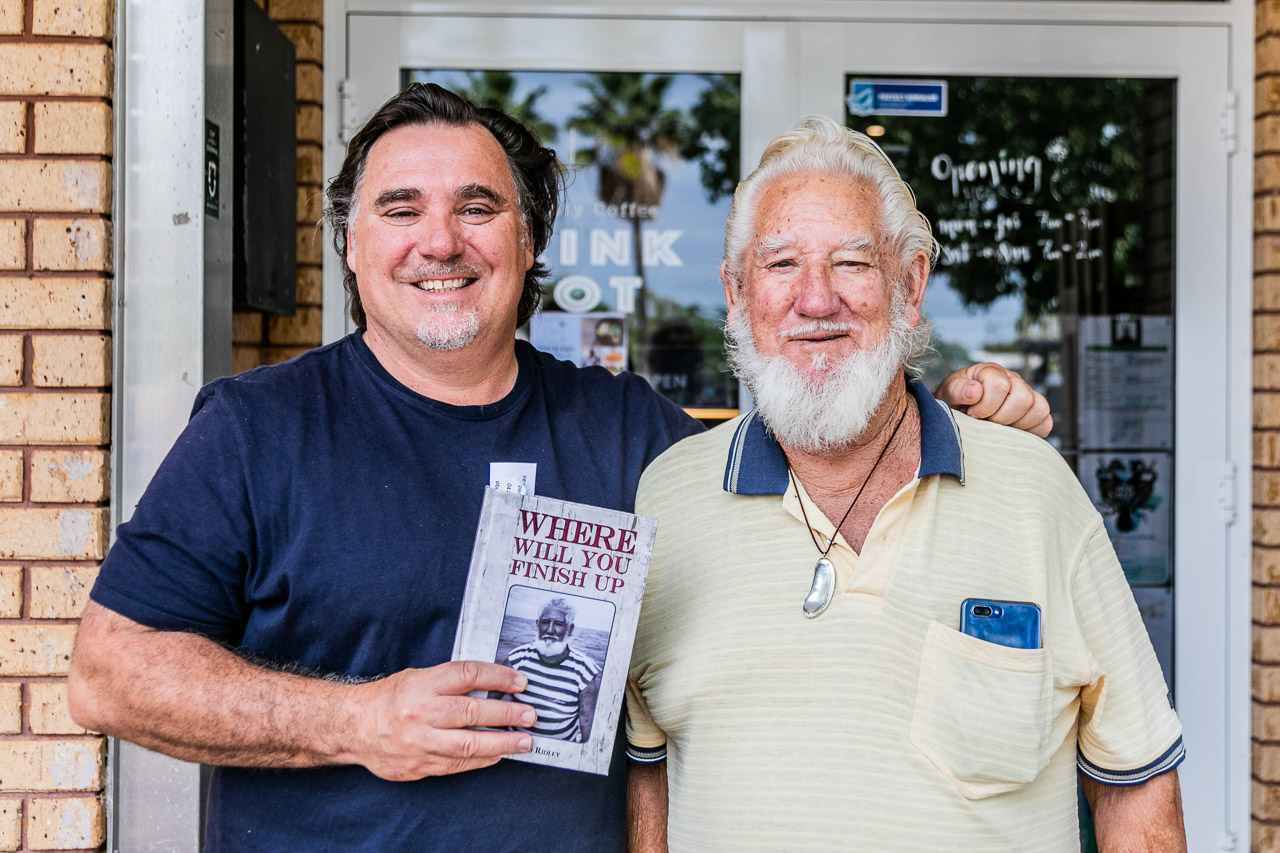 Alex Kailis with Pancho Ridley, and his freshly signed copy of Pancho's book