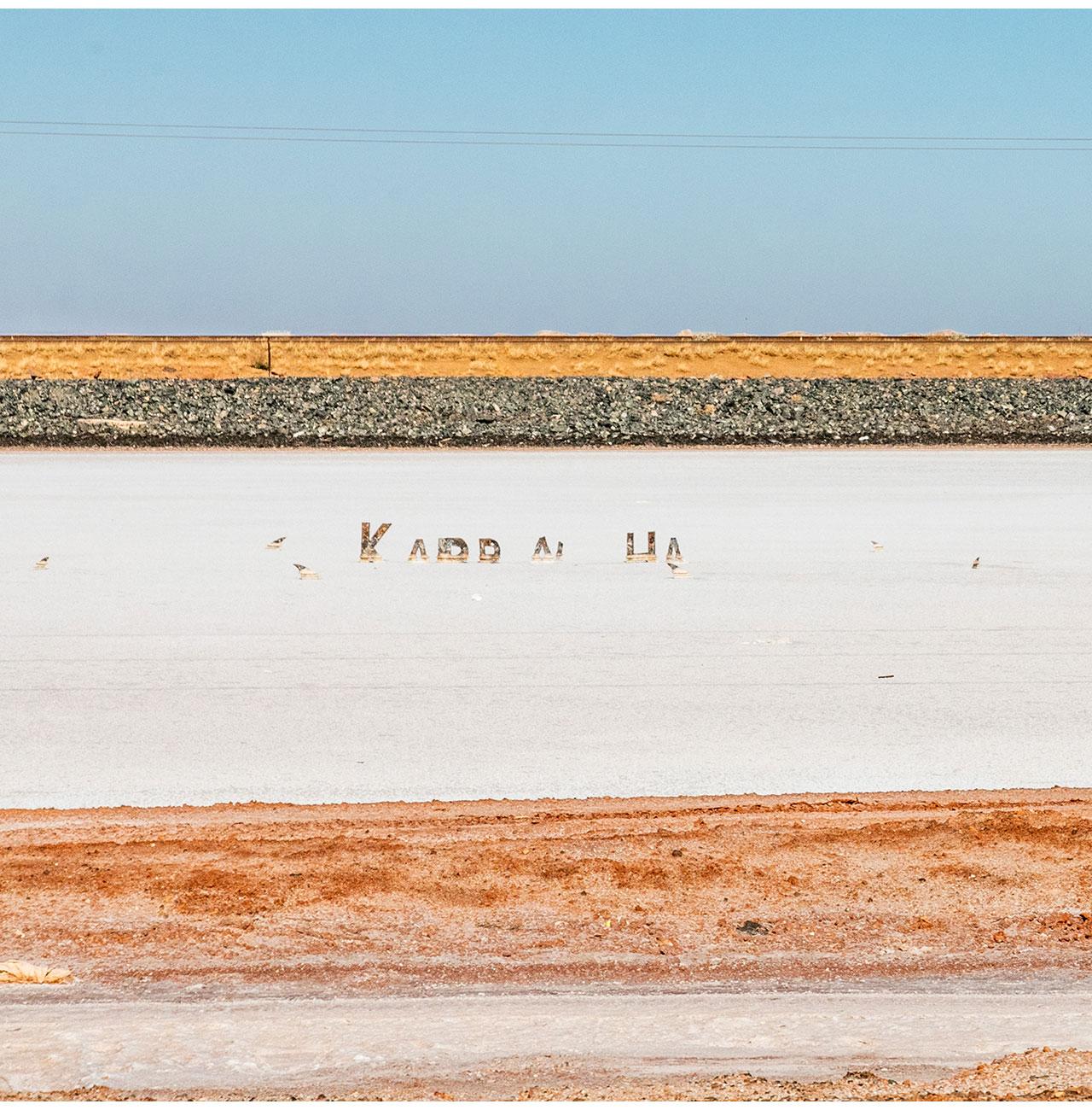 Horizontal lines of the railway track and salt flats near Karratha in the Pilbara region of Western Australia