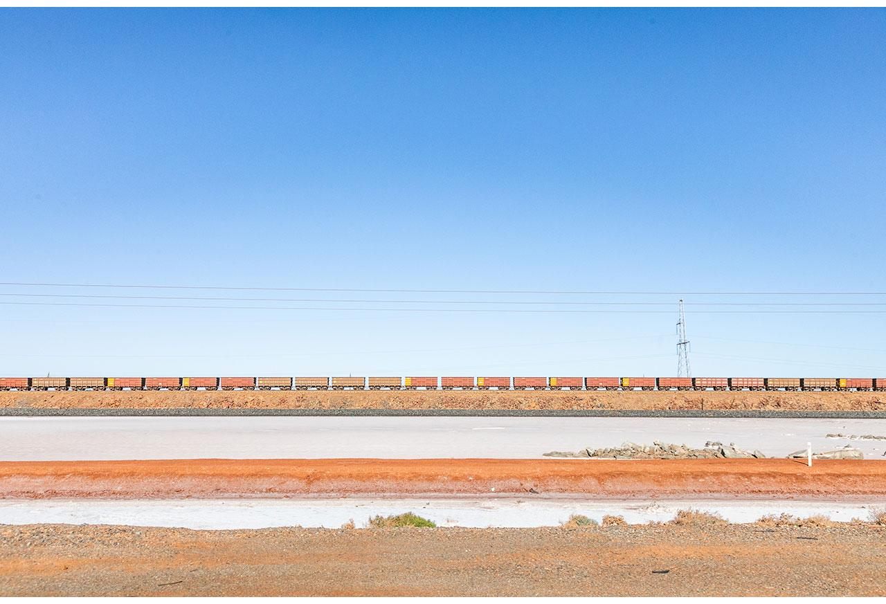 Empty wagons of a Rio Tinto train on the causeway near Karratha, Western Australia