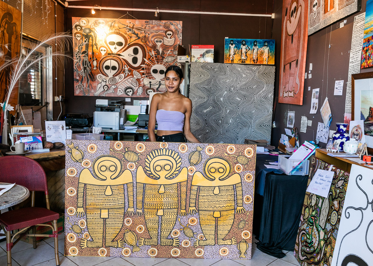 Local Aboriginal artist with her artwork in the Norval Gallery in Derby