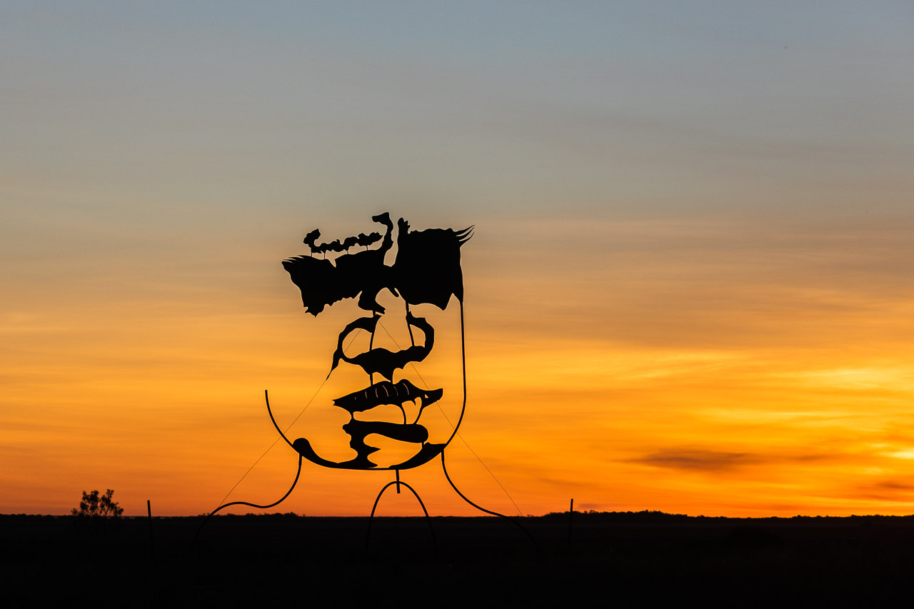 Mark Norval's six metre high sculpture on the marsh in Derby at sunset