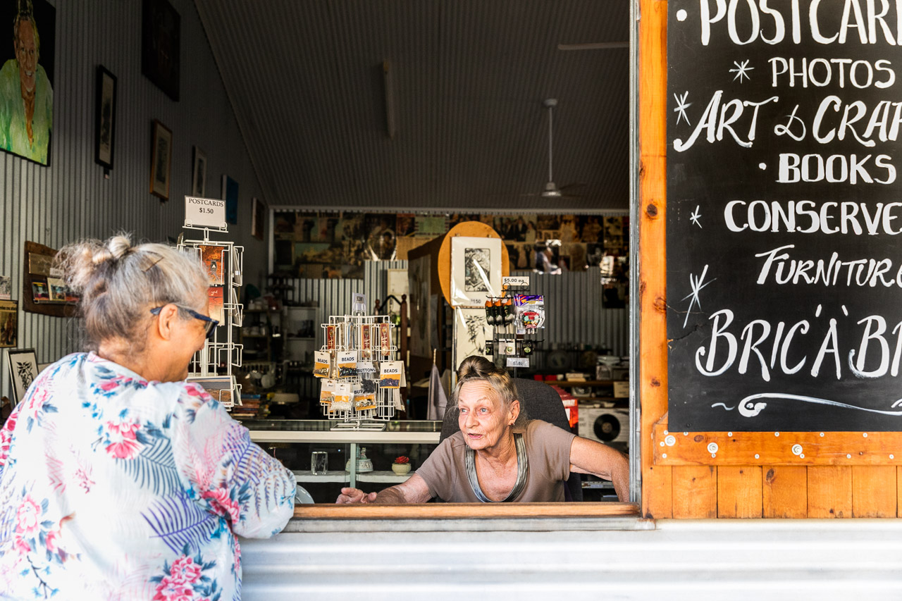 Pixie Ferguson at the window of her Tin Shed shop in Wyndham Port, WA