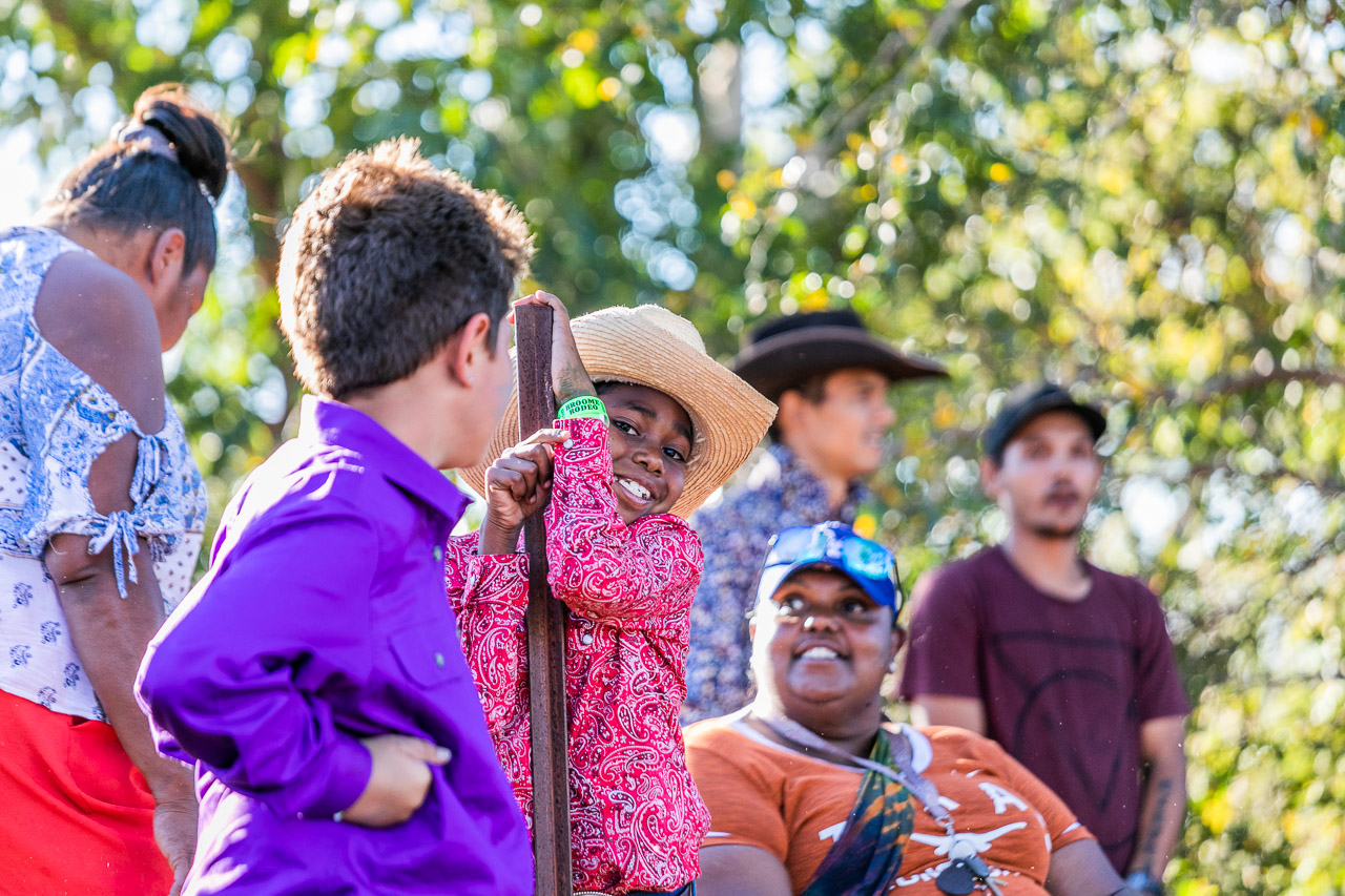 Cute Aboriginal boy in a cowboy hat with his family