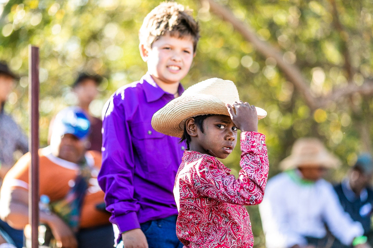 Aboriginal boy in a cowboy hat looking at the camera