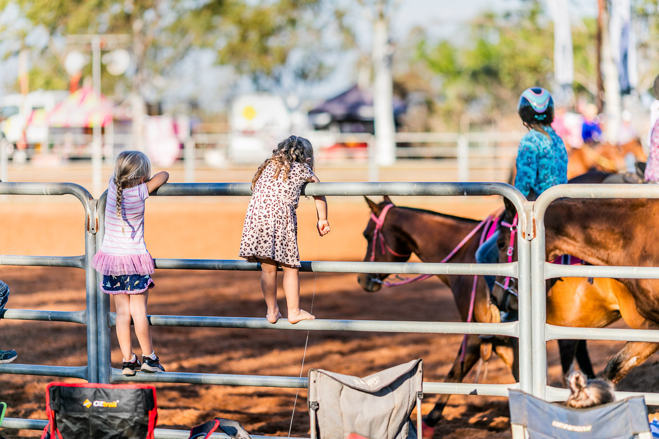 Small kids on the arena fence at the Broome Rodeo