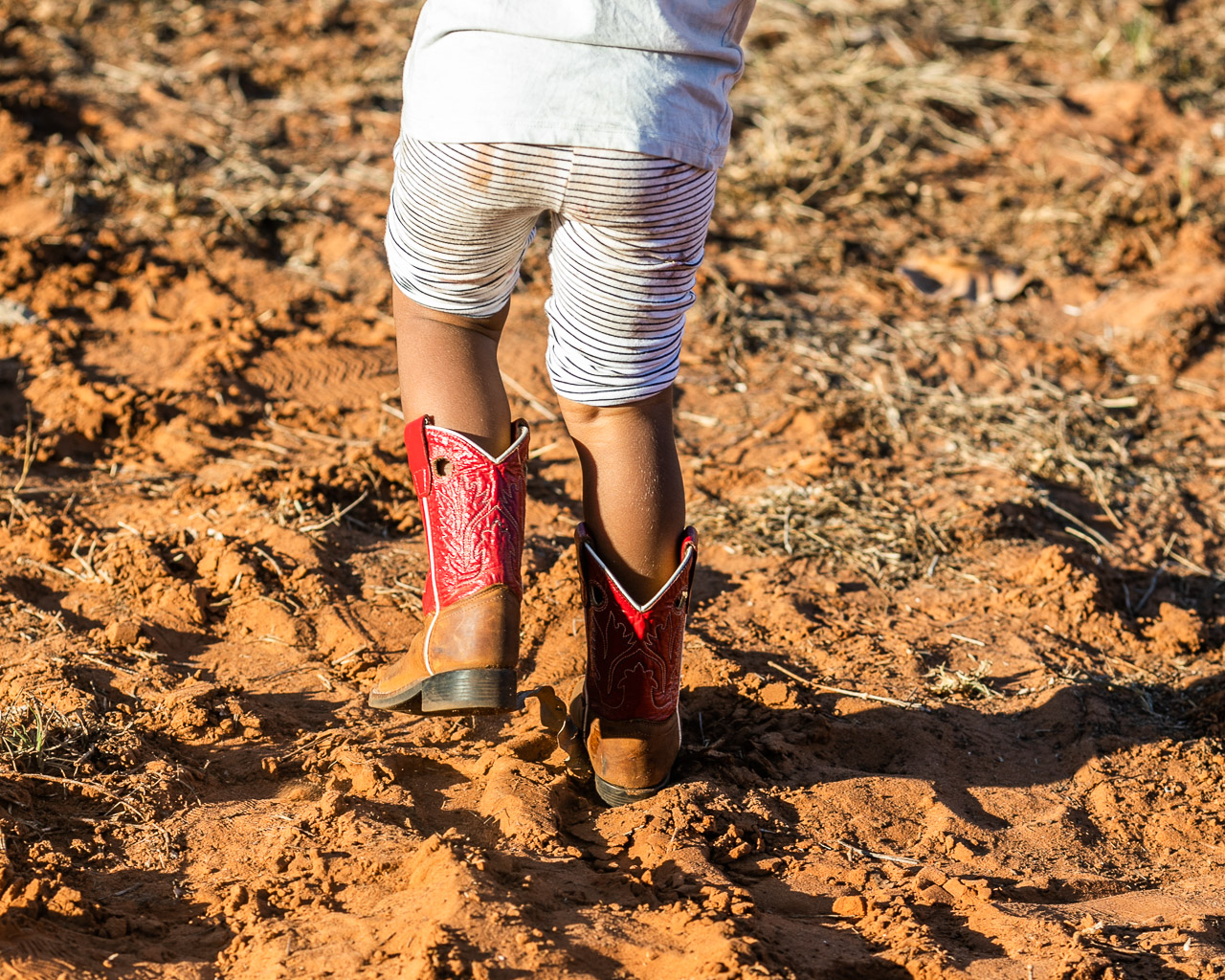 Red cowboy boots in the red dust at the Broome Rodeo