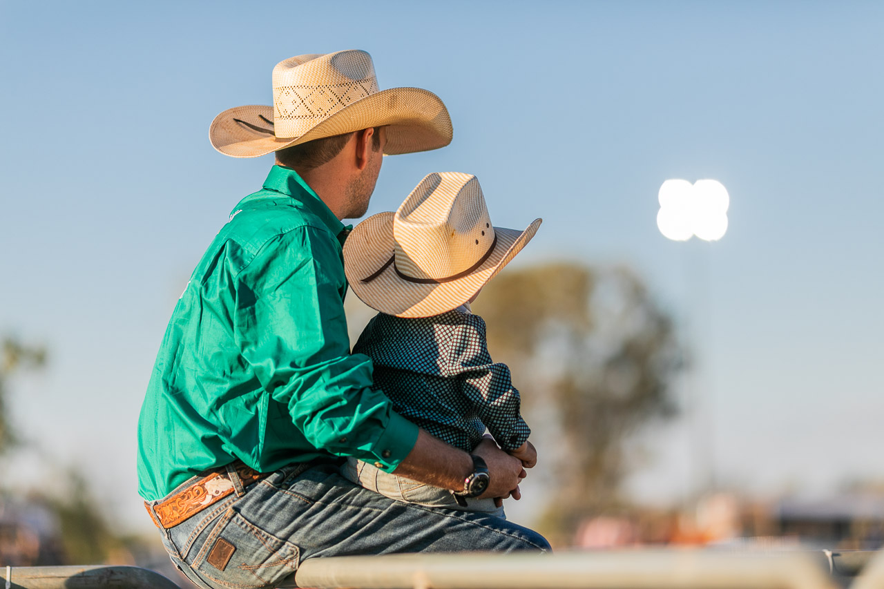 Father and baby son watching the rodeo - Broome Rodeo 2019