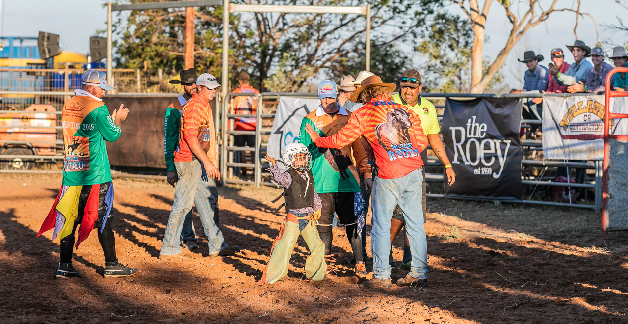 High-fives and congratulations for a young rodeo rider
