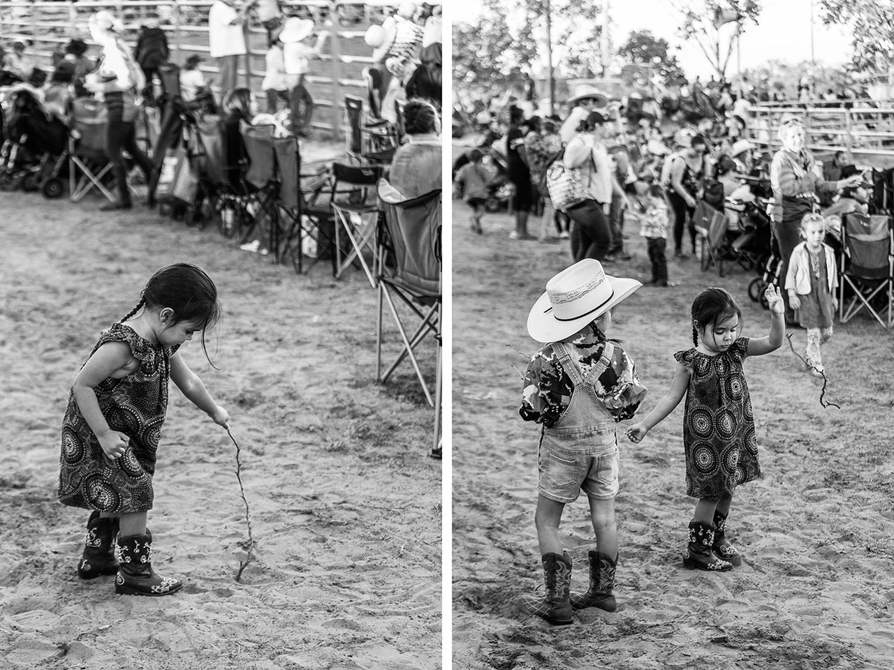 Young girls wearing cowboy boots drawing in the dirt with a stick at the Broome Rodeo