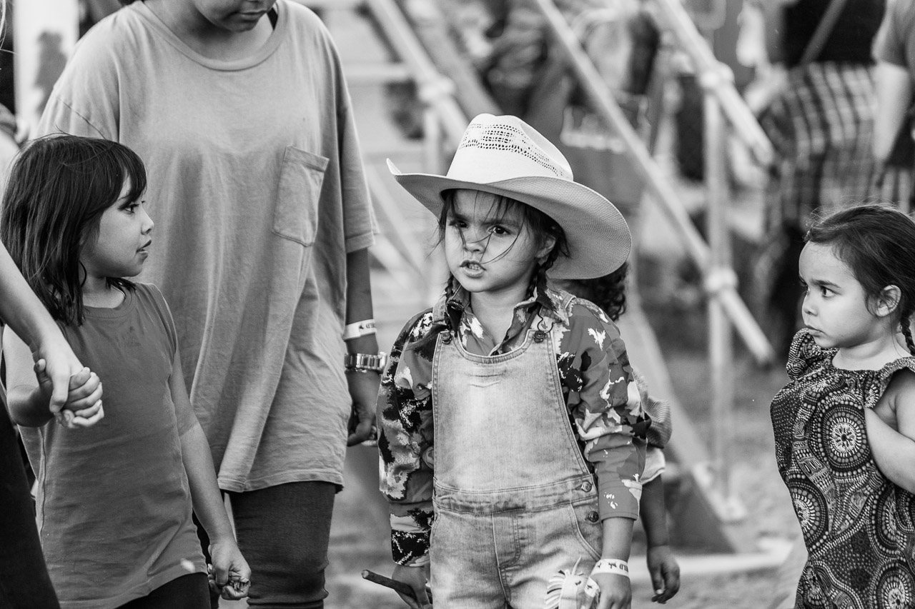 Young girl with a cowboy hat and some serious attitude is watched by her friends - Broome Rodeo 2019