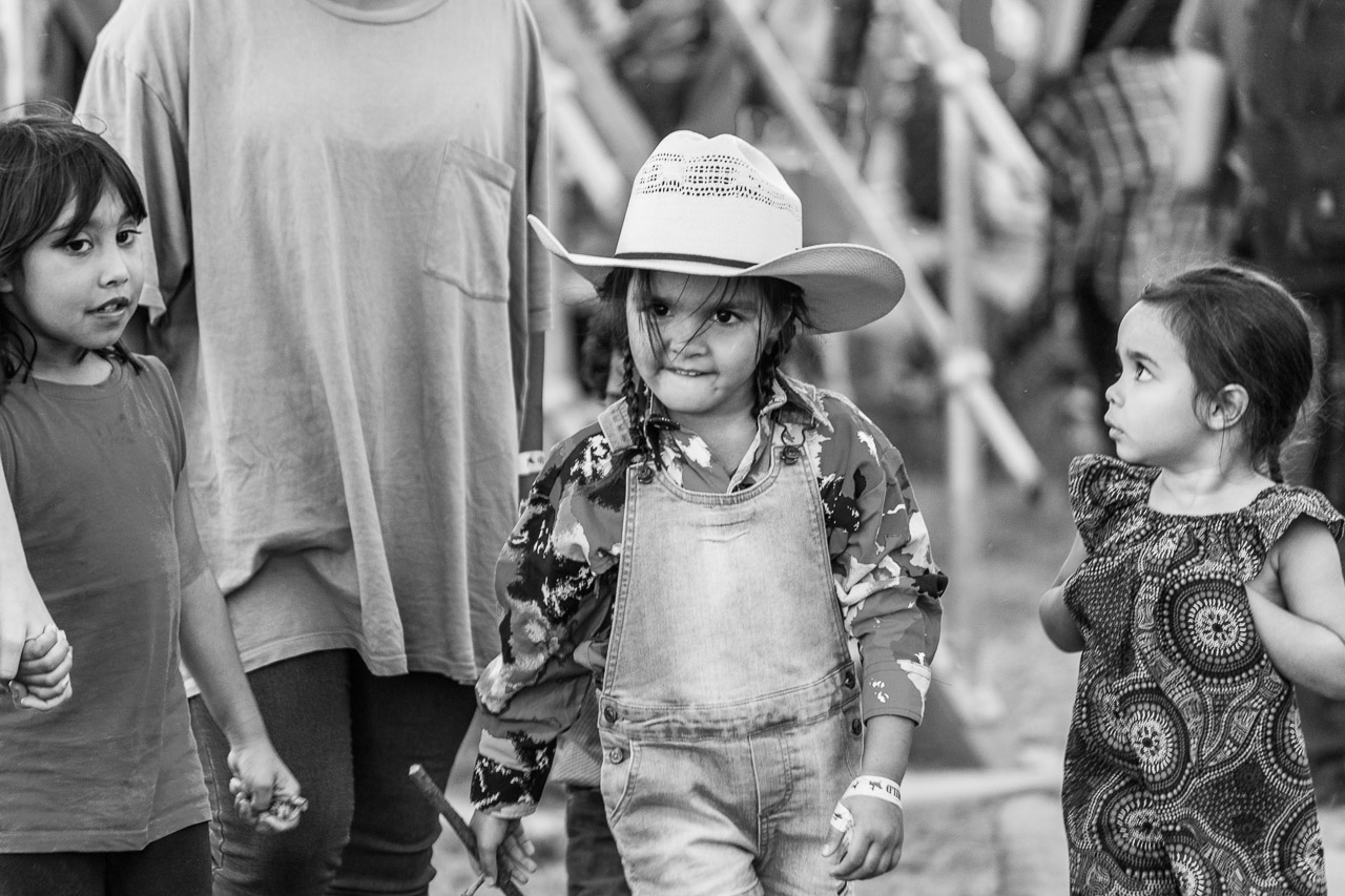 Young girl with a big cowboy hat and an even bigger attitude