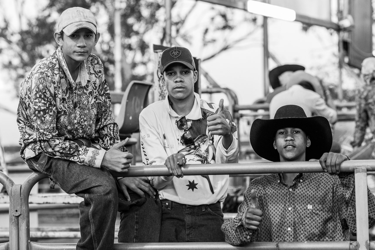 Three teenage boys at the rodeo