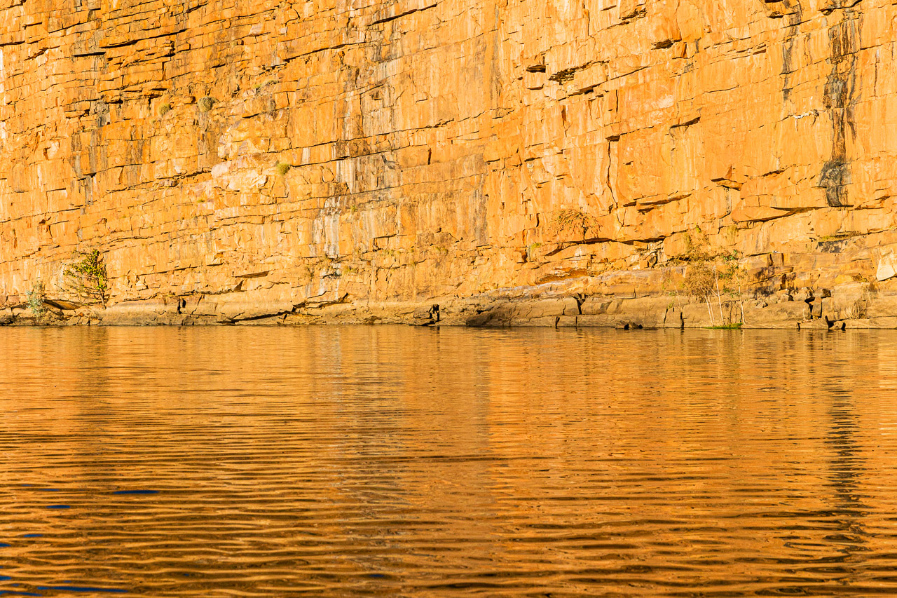 Golden reflections in the late afternoon sun at Chamberlain Gorge, El Questro in WA's Kimberley