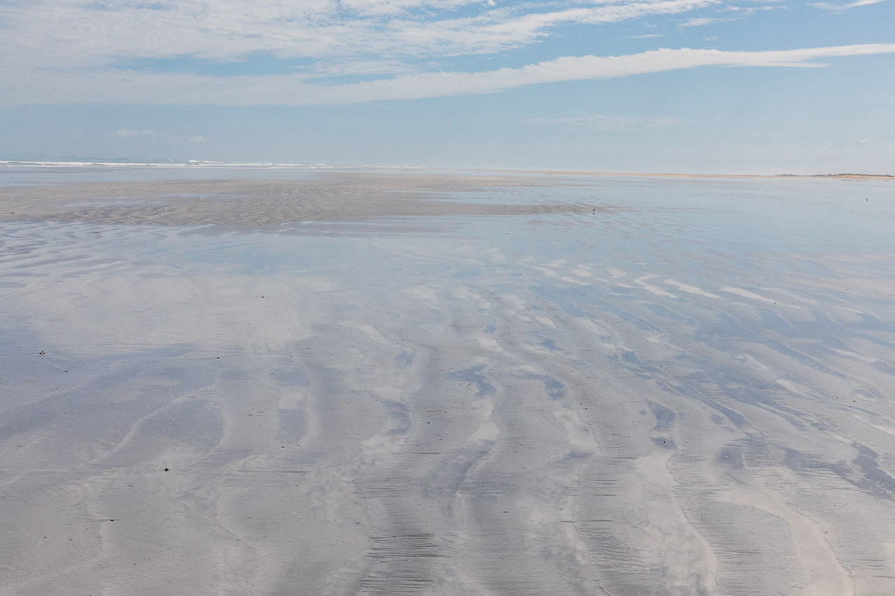 Sand patterns and cloud reflections at Cable Beach