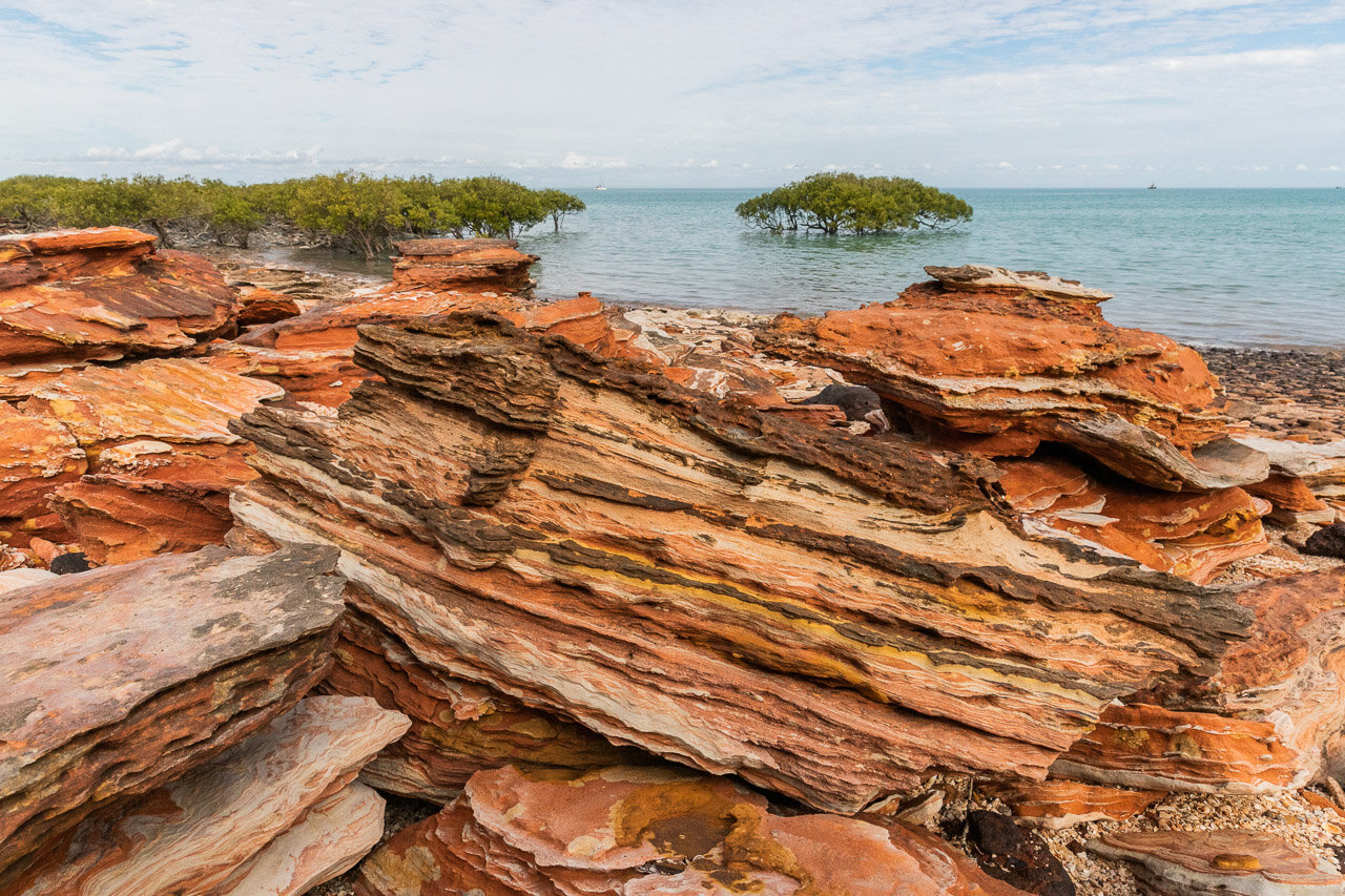 Rock patterns and mangroves at Broome's Town Beach