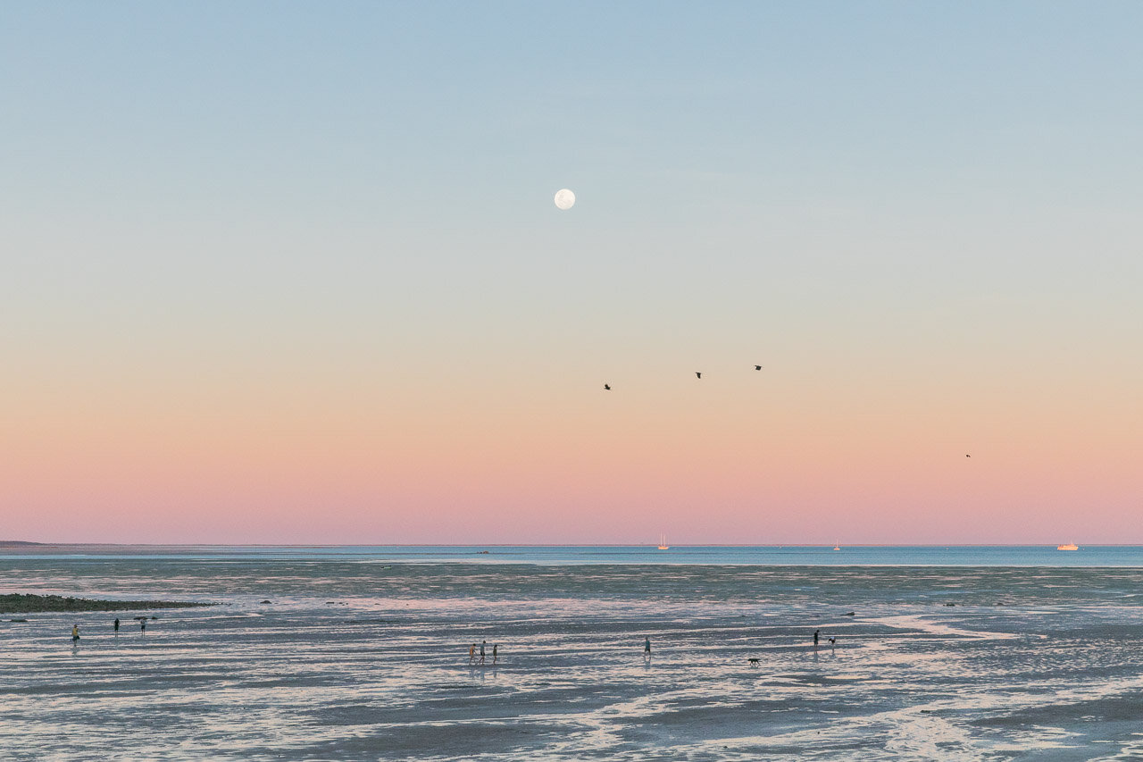 Evening strolls at low tide in the gentle evening light at Town Beach in Broome