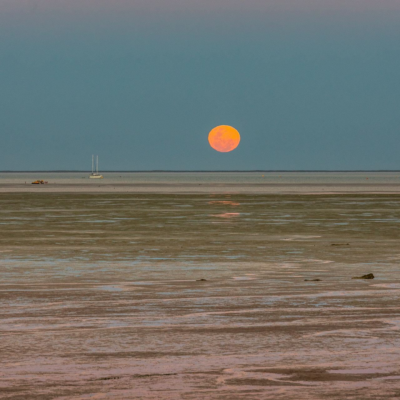 The moon rising over the tidal flat at Town Beach in Broome