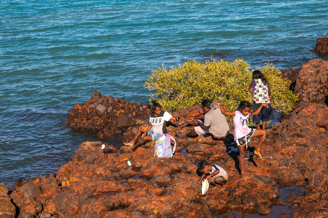 Family fishing off the rocks at Town Beach in Broome
