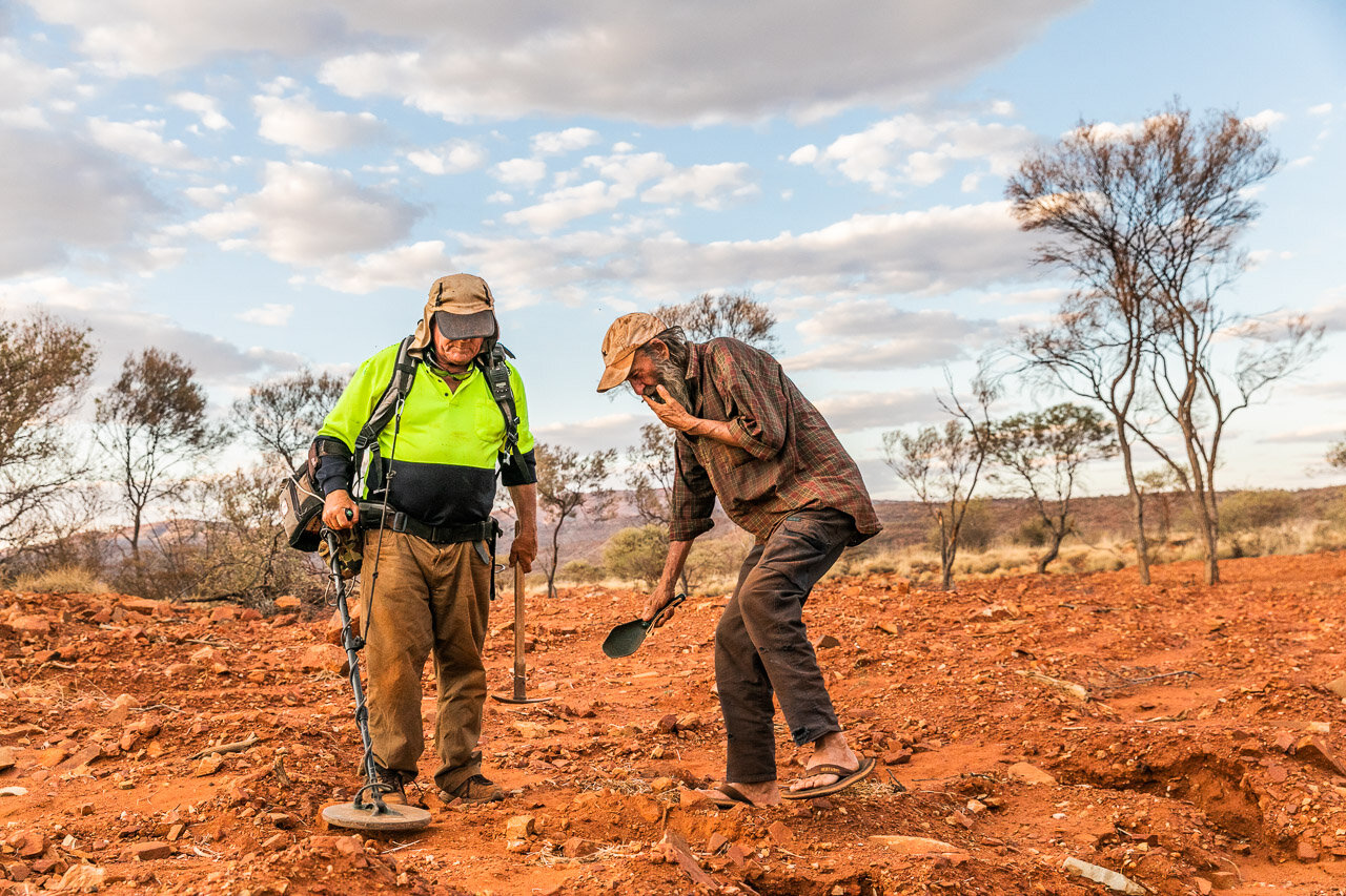 Two gold prospectors working as a team in the Pilbara