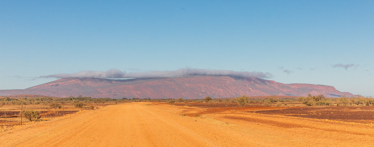 Morning sun and low cloud on Mount Augustus in WA's Goldfields