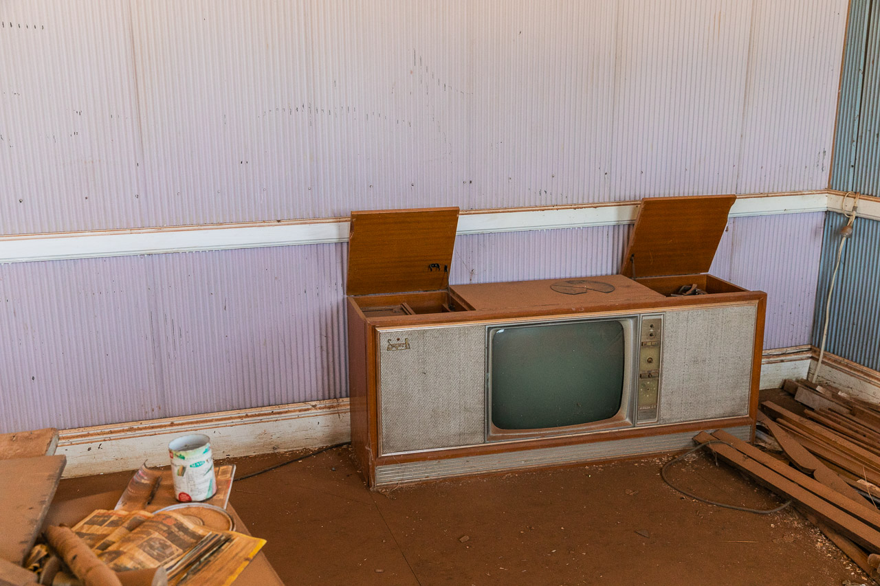An old TV and record player in the corner at the now deserted masonic lodge in Cue, Western Australia