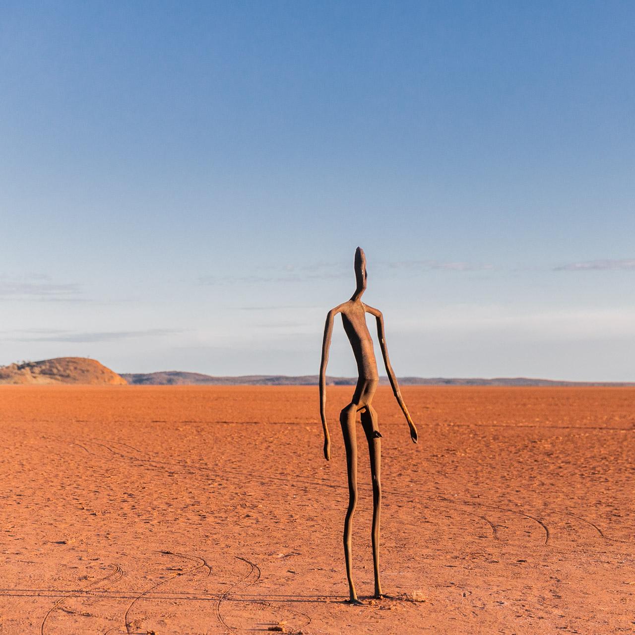 One of Antony Gormley's 51 sculptures on Lake Ballard in WA's Goldfields