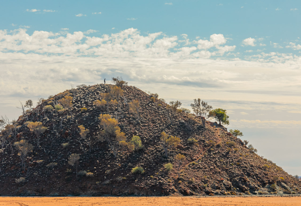 A man silhouetted on the hill at Lake Ballard