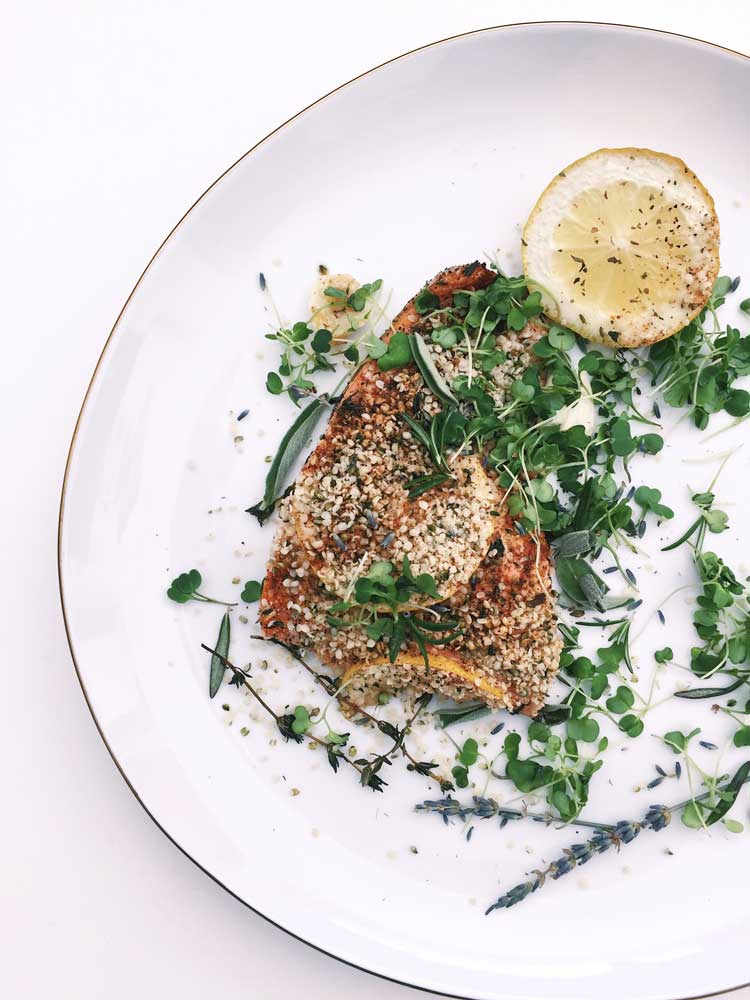 Hempseed Encrusted Salmon Recipe - Serve this delicious Hempseed Encrusted Salmon recipe by Fern Olivia from Thoughtfully Issue 9 on top of fresh seasonal greens and enjoy. Photography by Hannah Guthman.