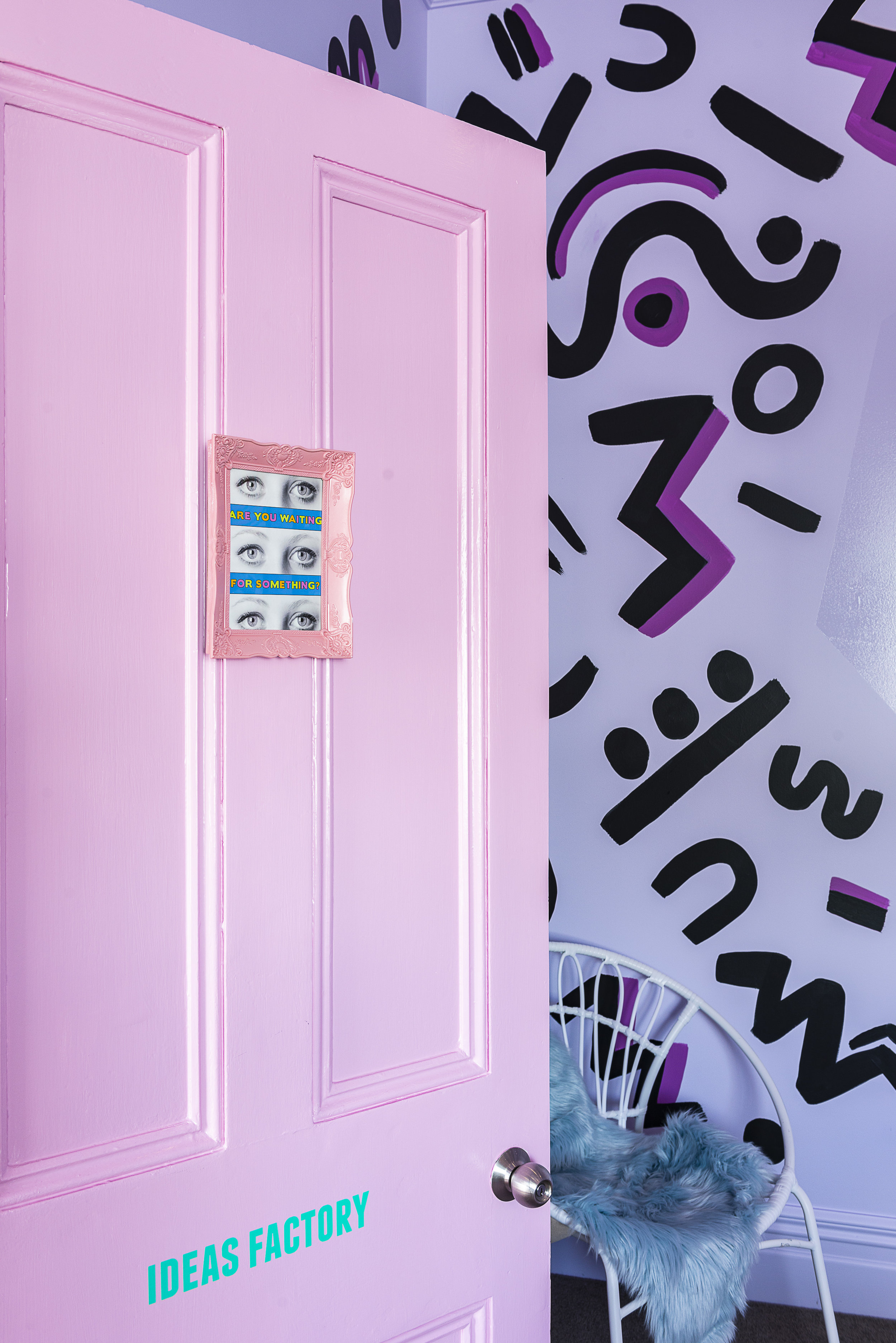 Each door features a Tyler Spangler print and custom signage to hint at what's inside.  Photograph by Helen Bankers