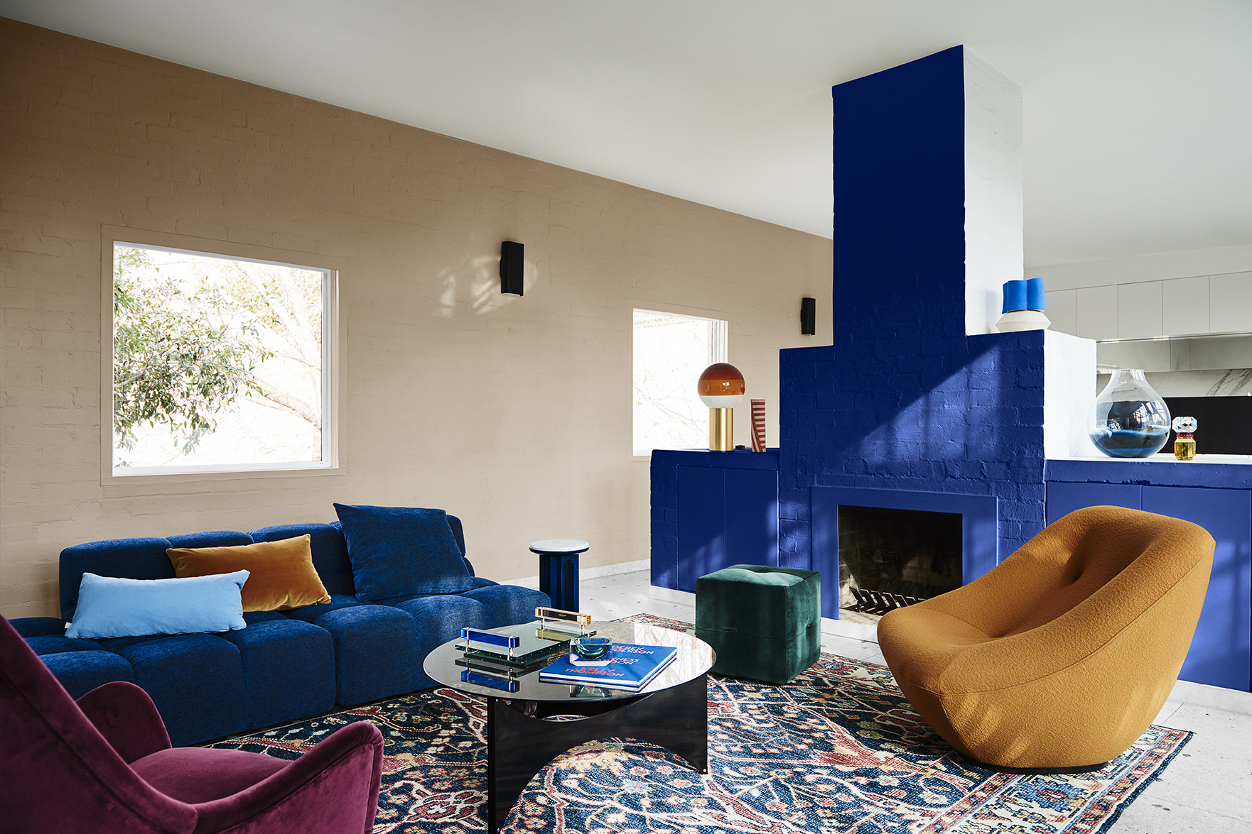 Styling by Bree Leech, Photographer Lisa Cohen.  Wall (rear) in Dulux Mt Maunganui, Fireplace sides and ceiling in Dulux Southern Alps, Fireplace in Dulux Master Blue.