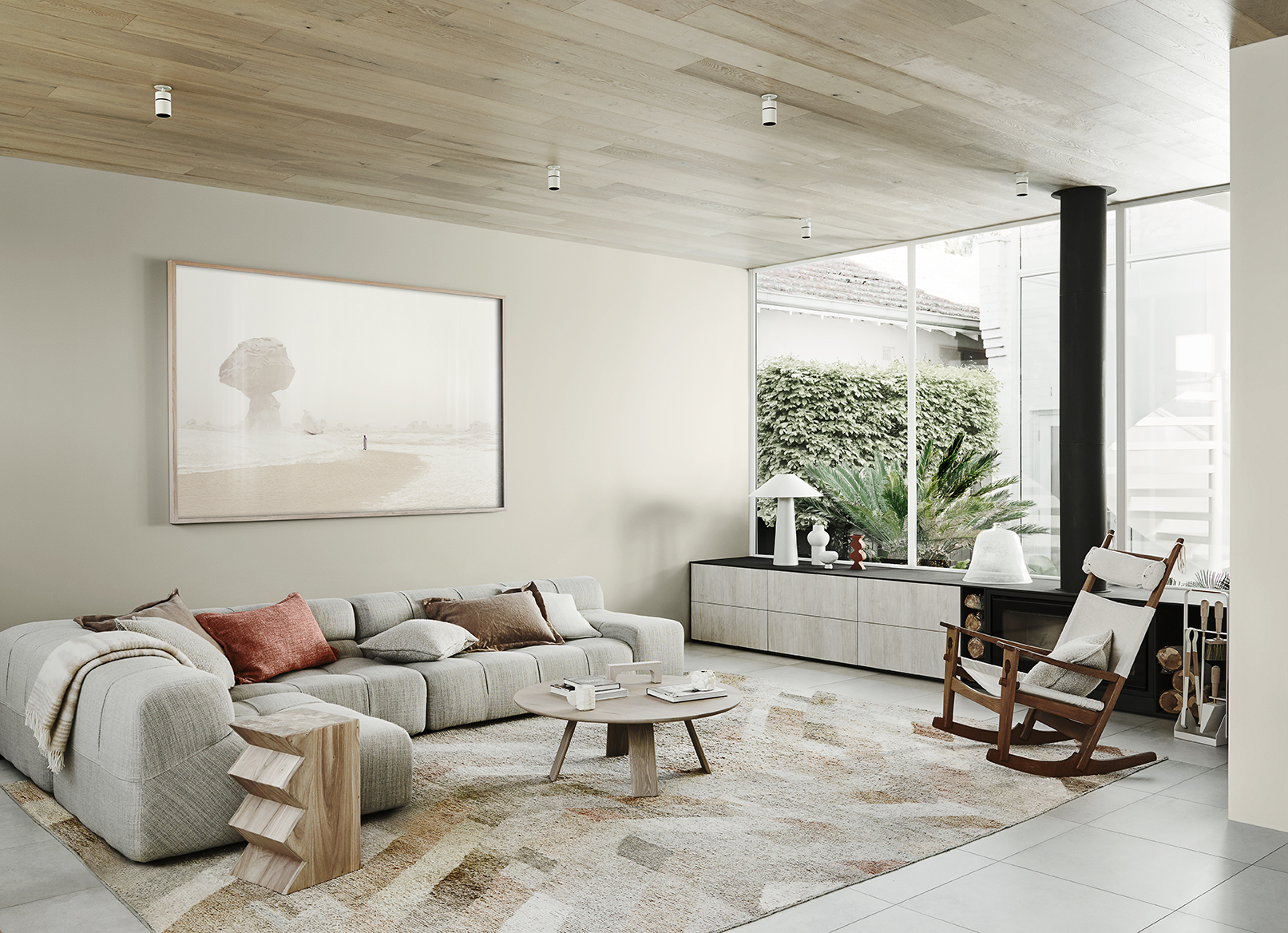 Styling by Bree Leech, Photographer Lisa Cohen.  Wall in Dulux Waitangi, wall in Dulux Sandfly Point Double (right)  Artwork: White Desert - Egypt by Chris Sisarich,  Maker's Mkt ;