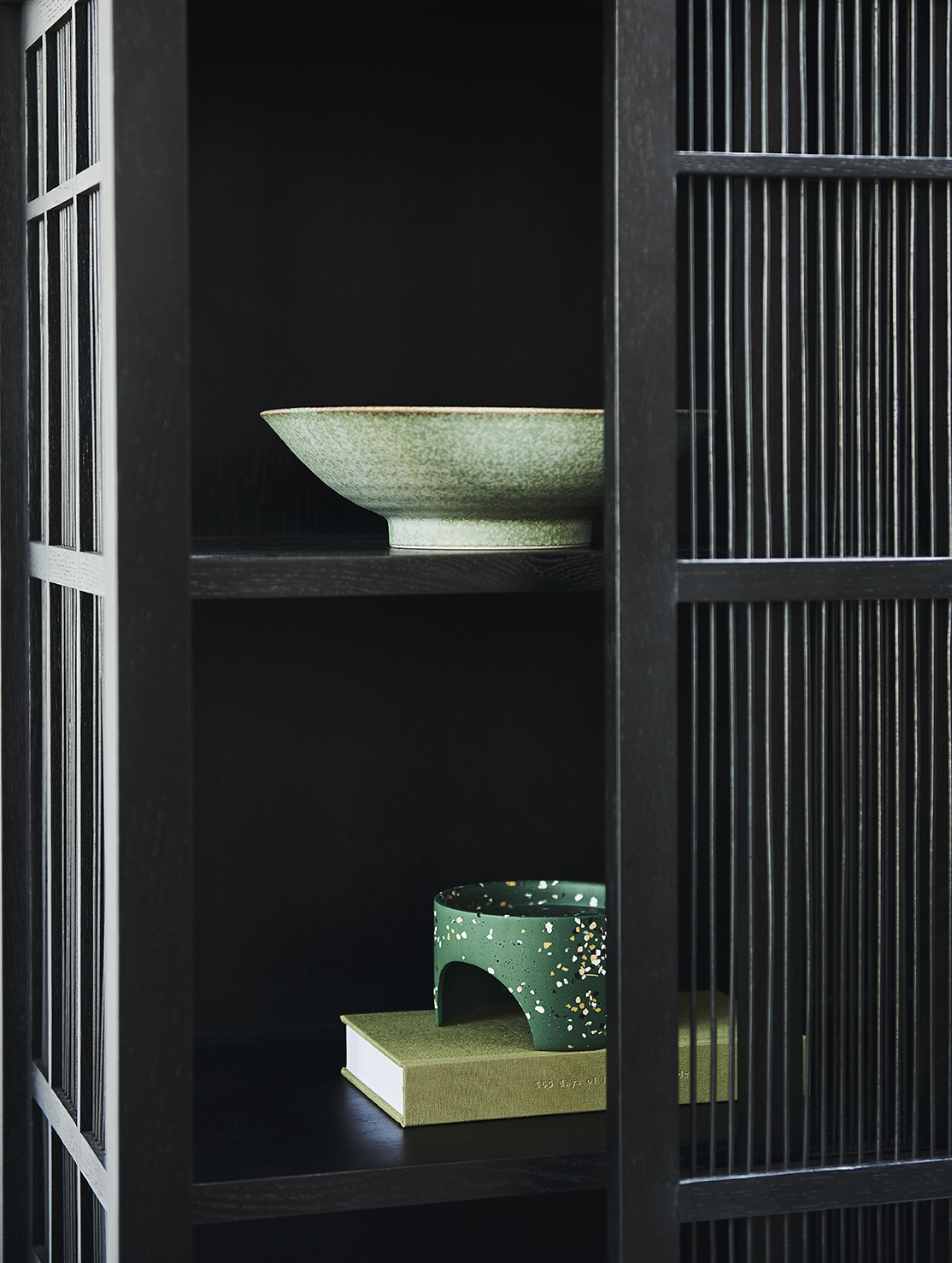 Styling by Bree Leech, Photographer Lisa Cohen.  Ehnicraft Oak Burung Storage Cupboard,  Trit House ; Japanese Ceramic Bowl Large in Green,  Safari Living ; Archie Pot in Emerald Terrazzo (stand only),  Capra Designs.