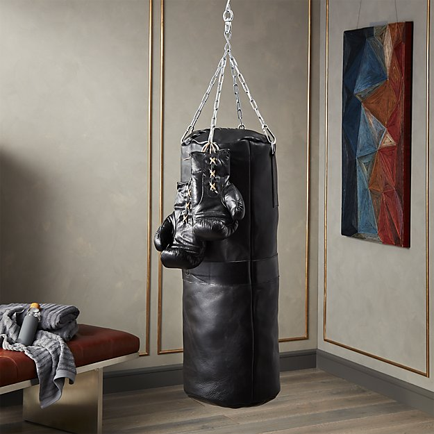 1. CB2-executive black leather punching bag & Boxing Gloves - $350- Punching Bag, $150- GlovesGentleman, take notes… because it doesn't get more masculine than this when it comes to home decor. This set is the perfect statement piece for your bachelor pad that will have both the men and the ladies swooning alike. It just doesn't get better than leather, no matter what it is. However, there is one downside… the bag does not come stuffed. But the way I see it, what could be more manly than stuffing a punching bag? I sure can't think of anything.