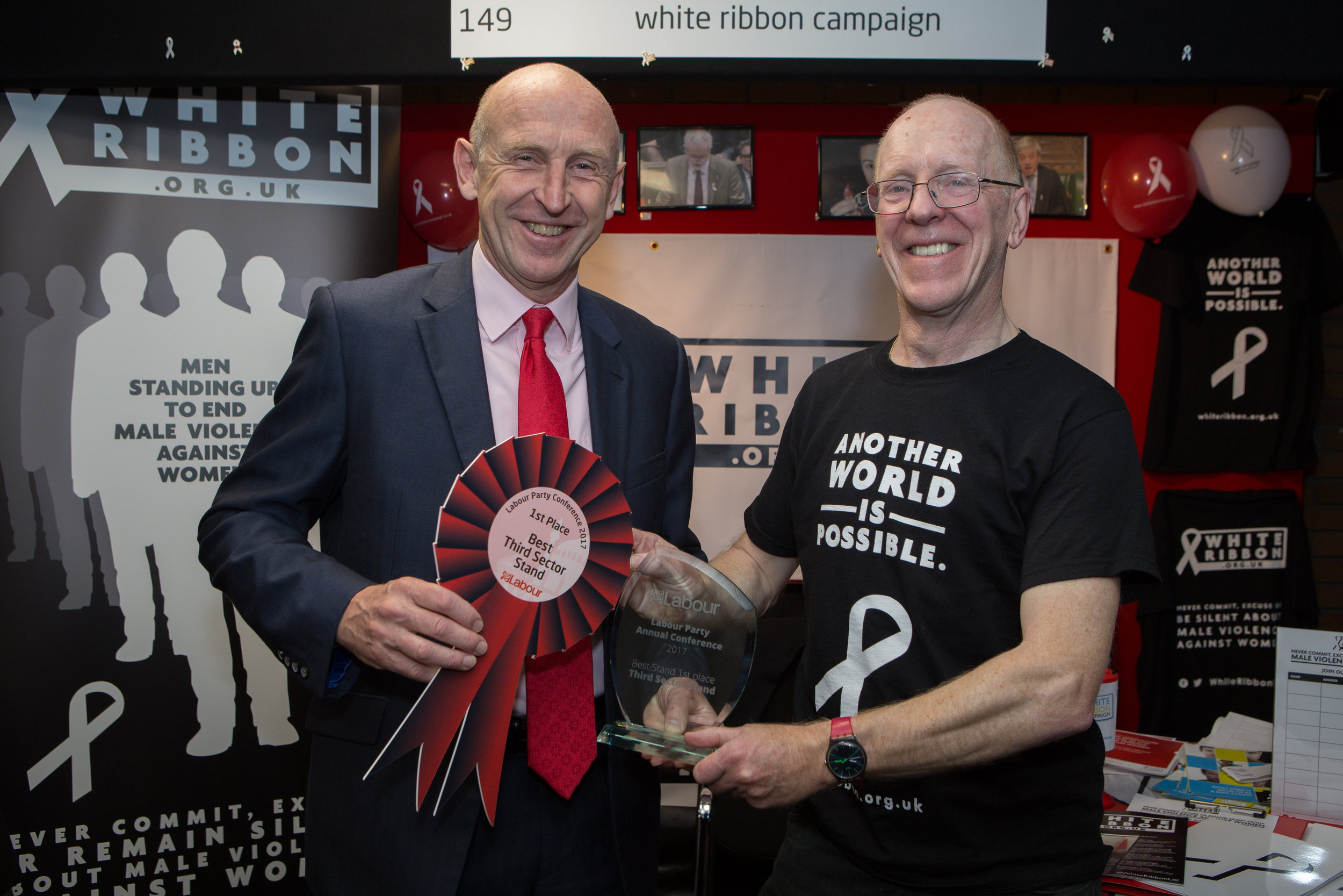 John Healey MP, Shadow Housing Minister, presents our founder Chris Green OBE with the award for Best Third Sector Stand, as voted for by conference attendees.