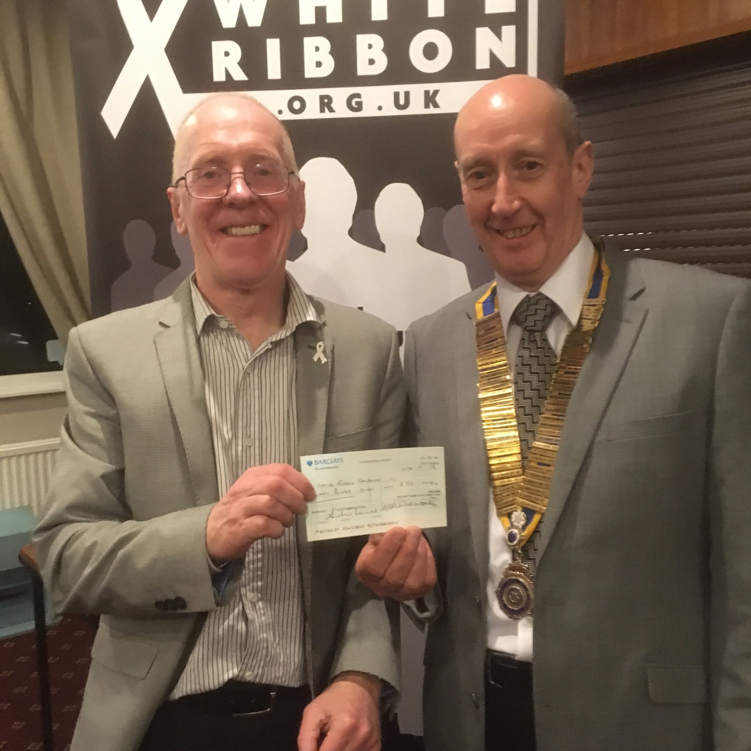 Elland Rotary presenting a cheque after hearing about the activities of White Ribbon UK  from Chris Green OBE