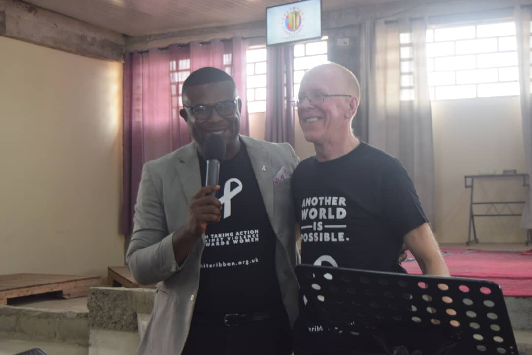 Campaign Coordinator Derek B, with White Ribbon UK Founder and President, Chris Green OBE, speaking at Power City Chapel in Accra to a packed congregation