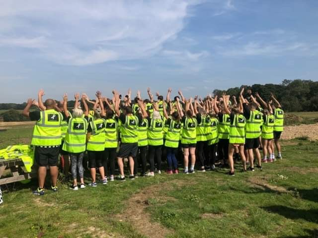 Participants wearing hi-vis jackets with Grace's name on the back together with the White Ribbon logo.