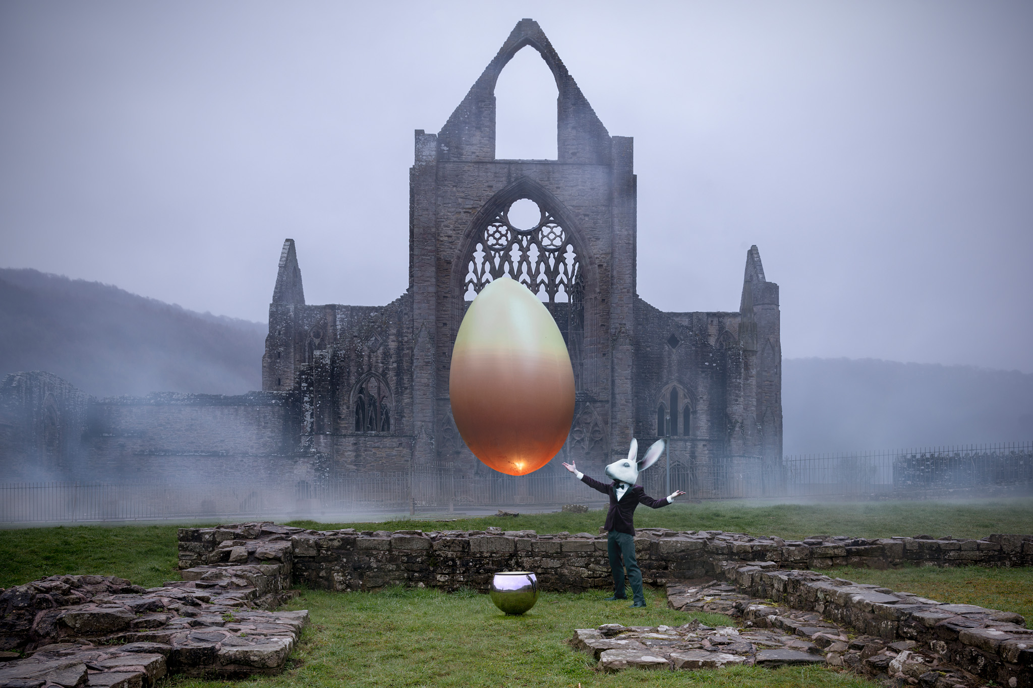The floating egg was created by the ingenious folk at  Guineapig . It was filled with a mix of helium and air and floated over a jet of air from the chrome ball below. Photographed at Tintern Abbey