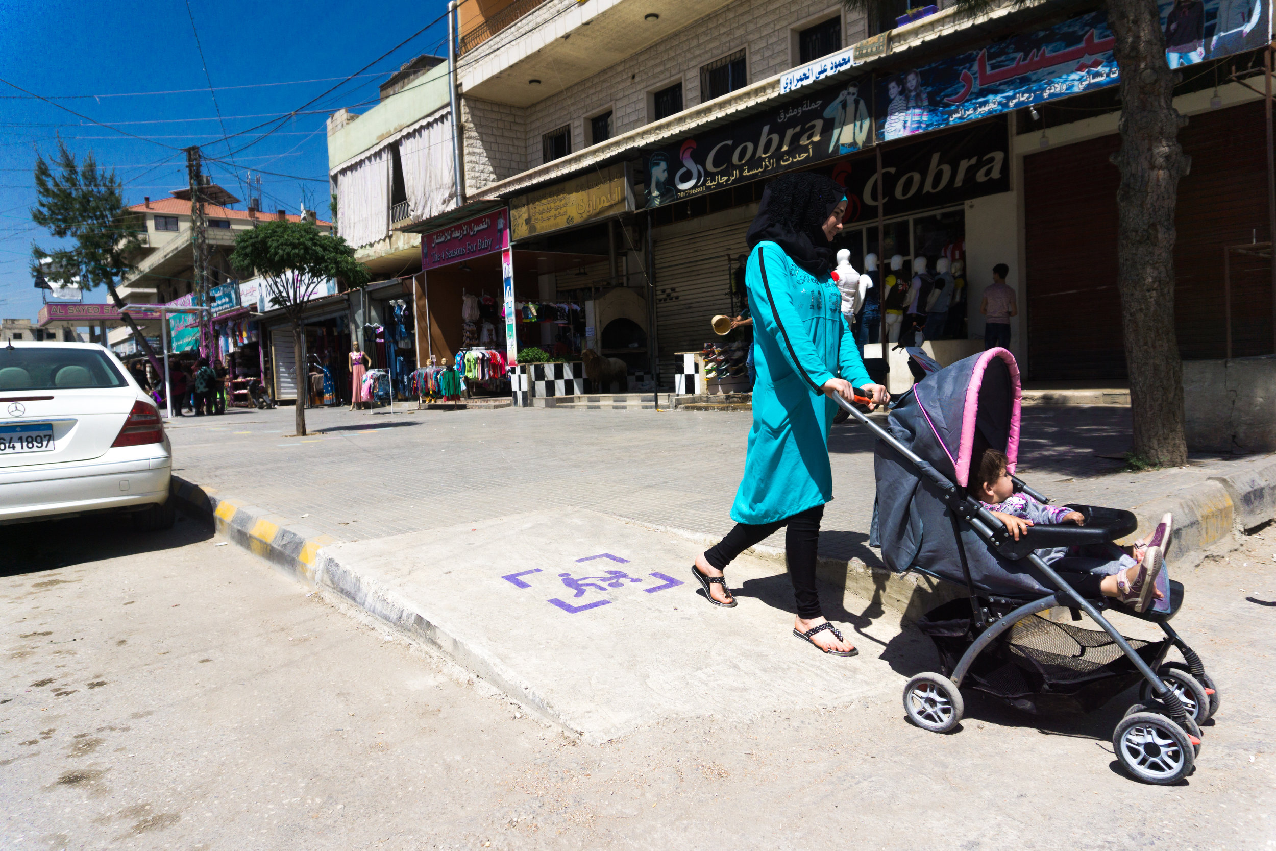 (c) CatalyticAction - woman with stroller using newly installed ramp