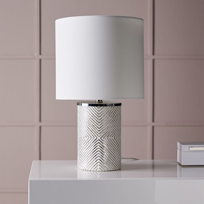 Etched Glass Table Lamp - This table lamp is so simple, yet has so much character to it. Gold is in on everything right now, but I feel like silver is a classic. If you're looking for something to pair well with white, this is it! You can find it HERE.