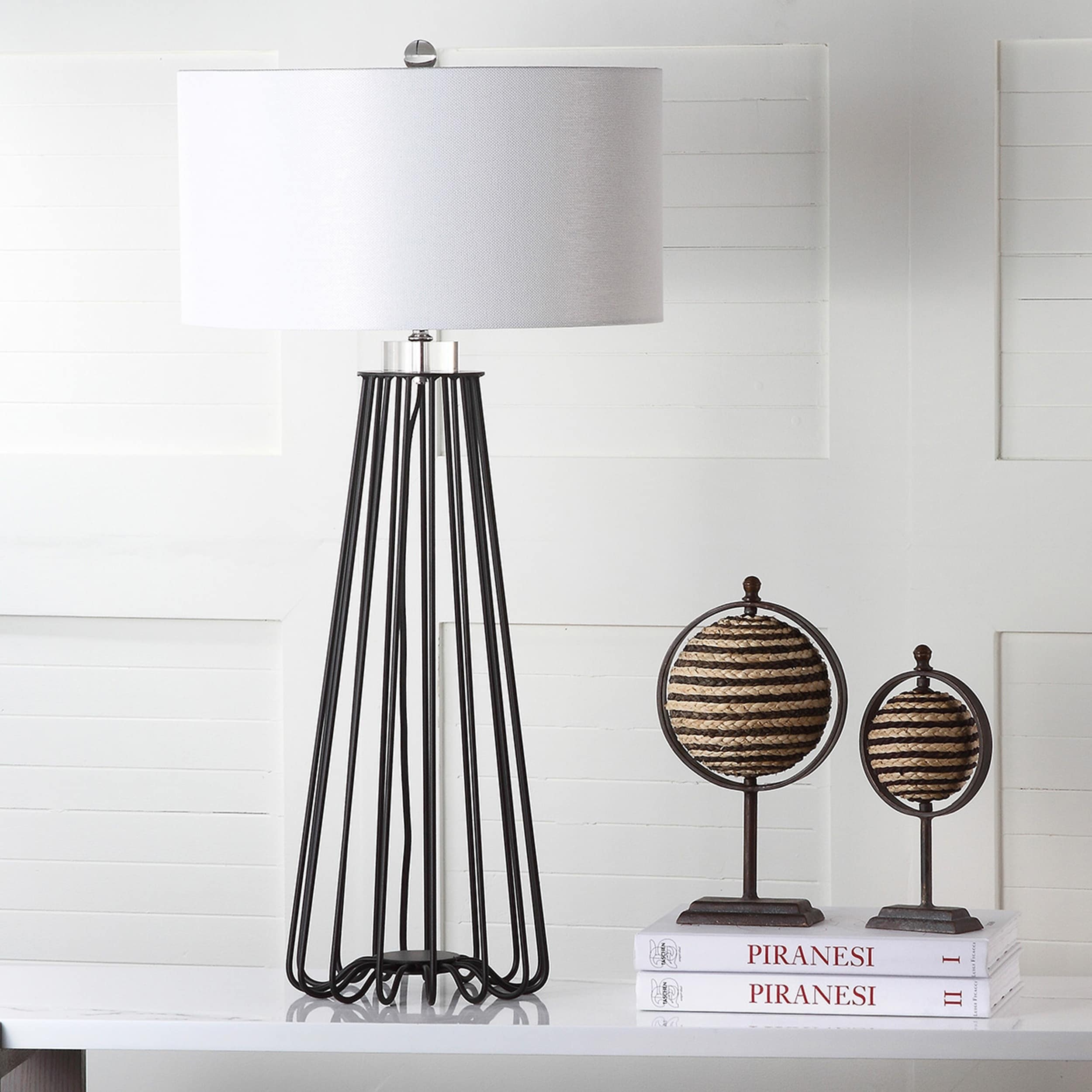 Black Metal Table Lamp - I love the contrast of black and white in this lamp. It looks like a timeless piece because black and white are the classics! I also love how tall this lamp is because sometimes you need something a little more substantial on your desk or table. This comes in a set of two and is currently on sale! Snag it HERE if you like it!