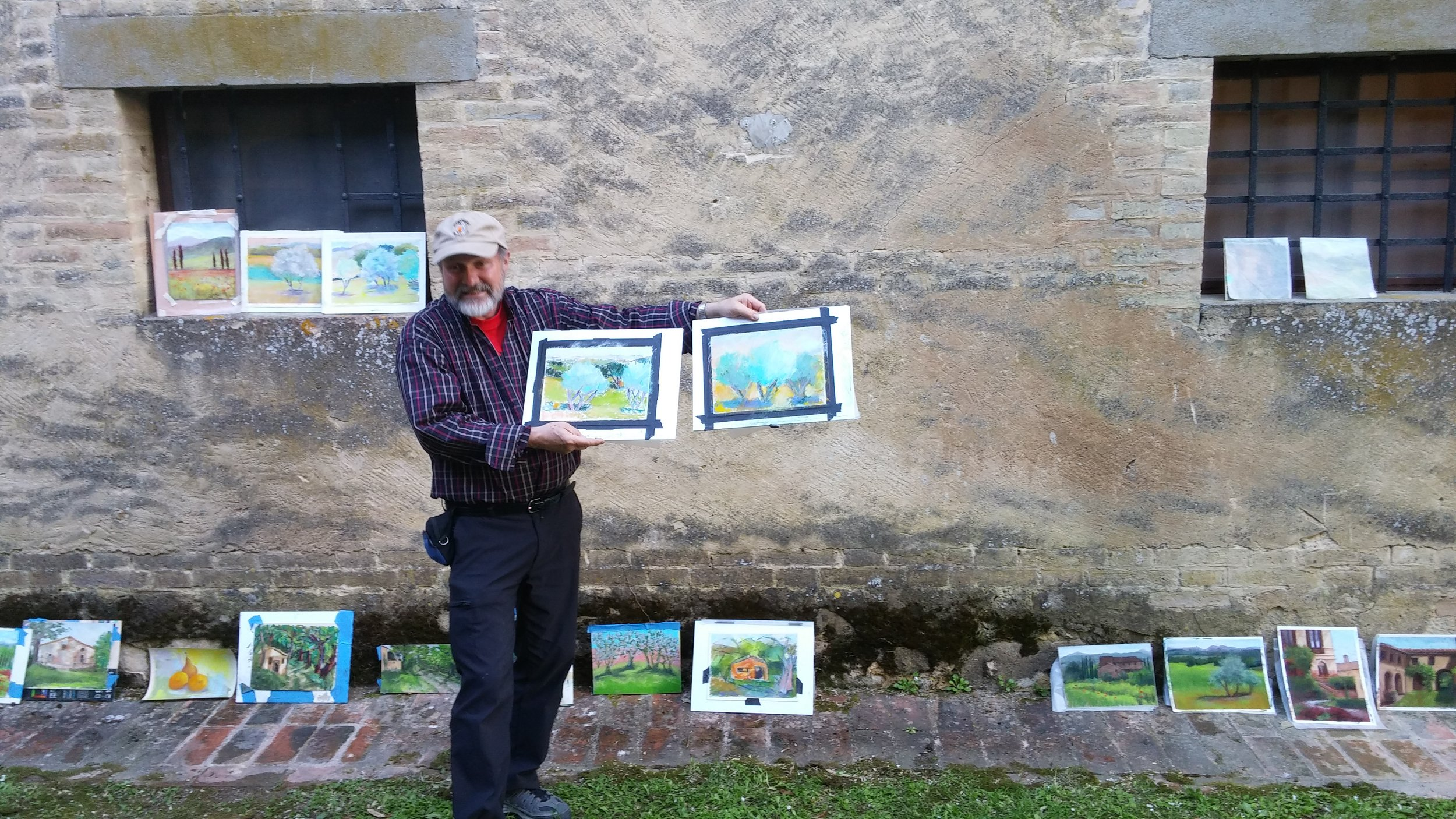 Well known pastel instructor Robert Carston offers critiques at end of a week's work in Tuscany.