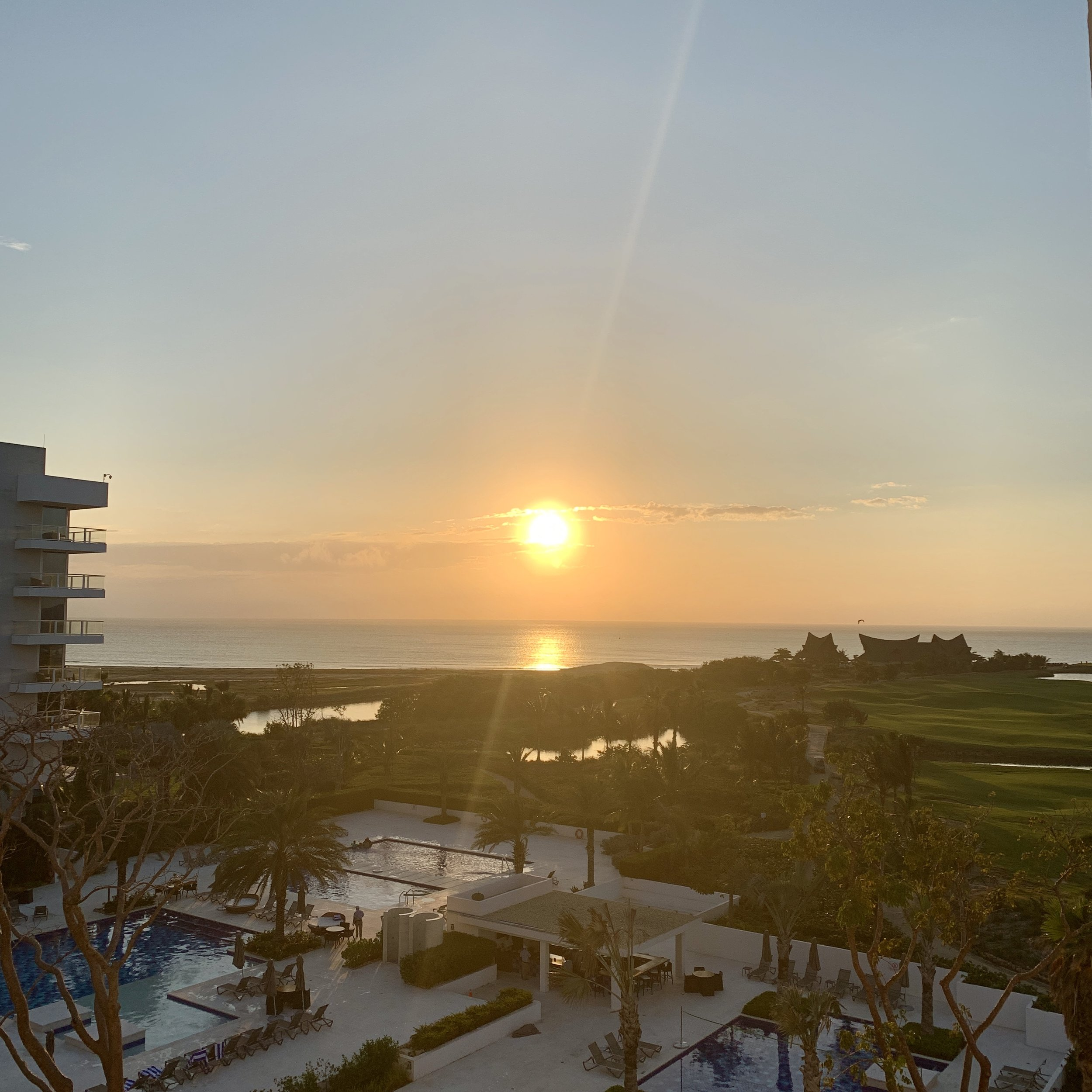 Sunrise, as seen from my suite. (That's the resort's beach club in the distance.)