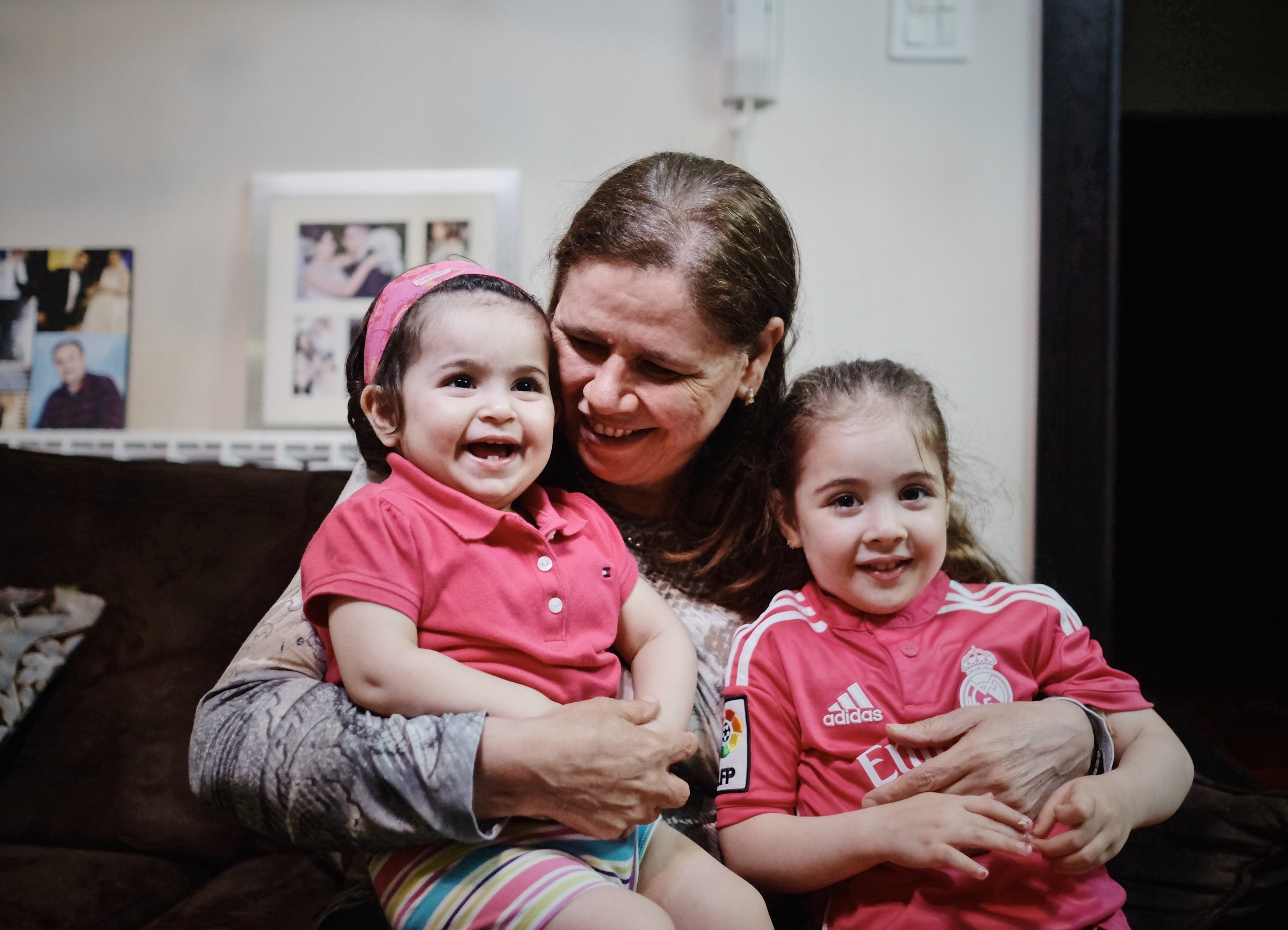 Fadwa Barghouti with her grandchildren Talia and Sarah.Published by Women in the World in association with The New York Times.
