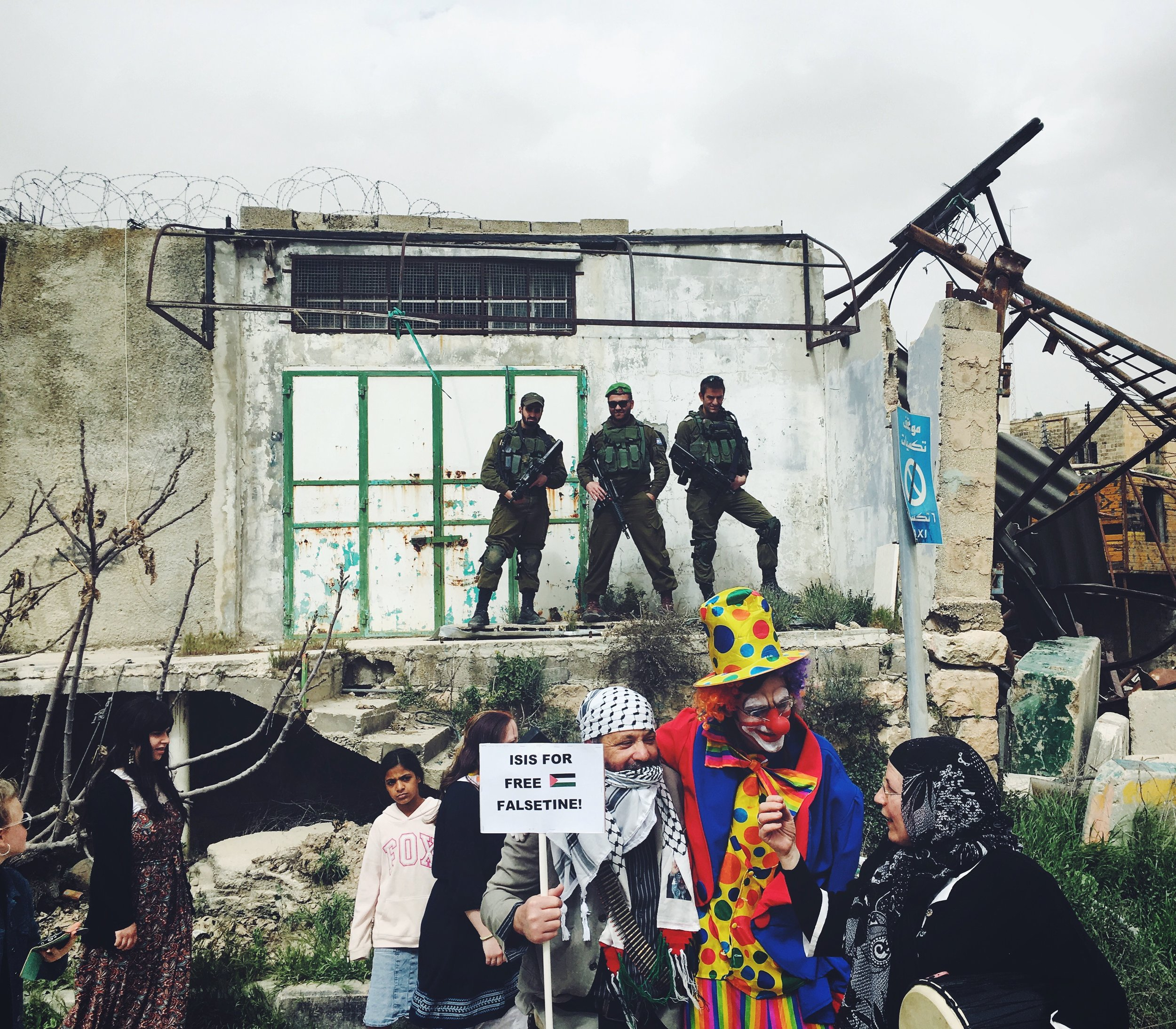 """A fringe group of settlers in the West Bank city of Hebrom celebrating Purim.Costumes from left to right: terrorist, clown and """"Palestinian woman."""""""