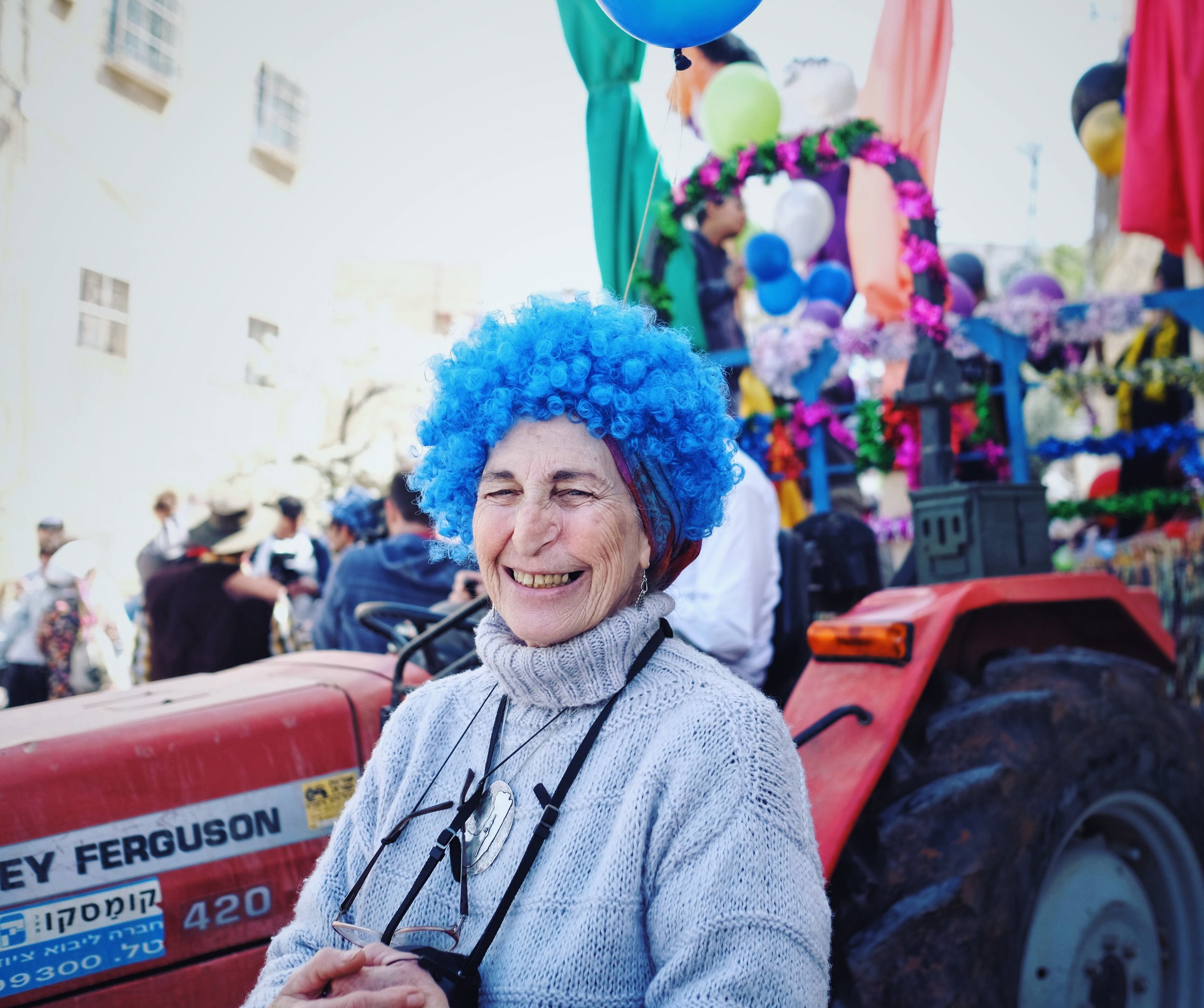 """Tamar Halfon from South Carolina celebrates Purim in the West Bank city of Hebron.I asked about the camera around her neck. """"If they throw a stone, now I'll be able to know who it was"""" she said."""