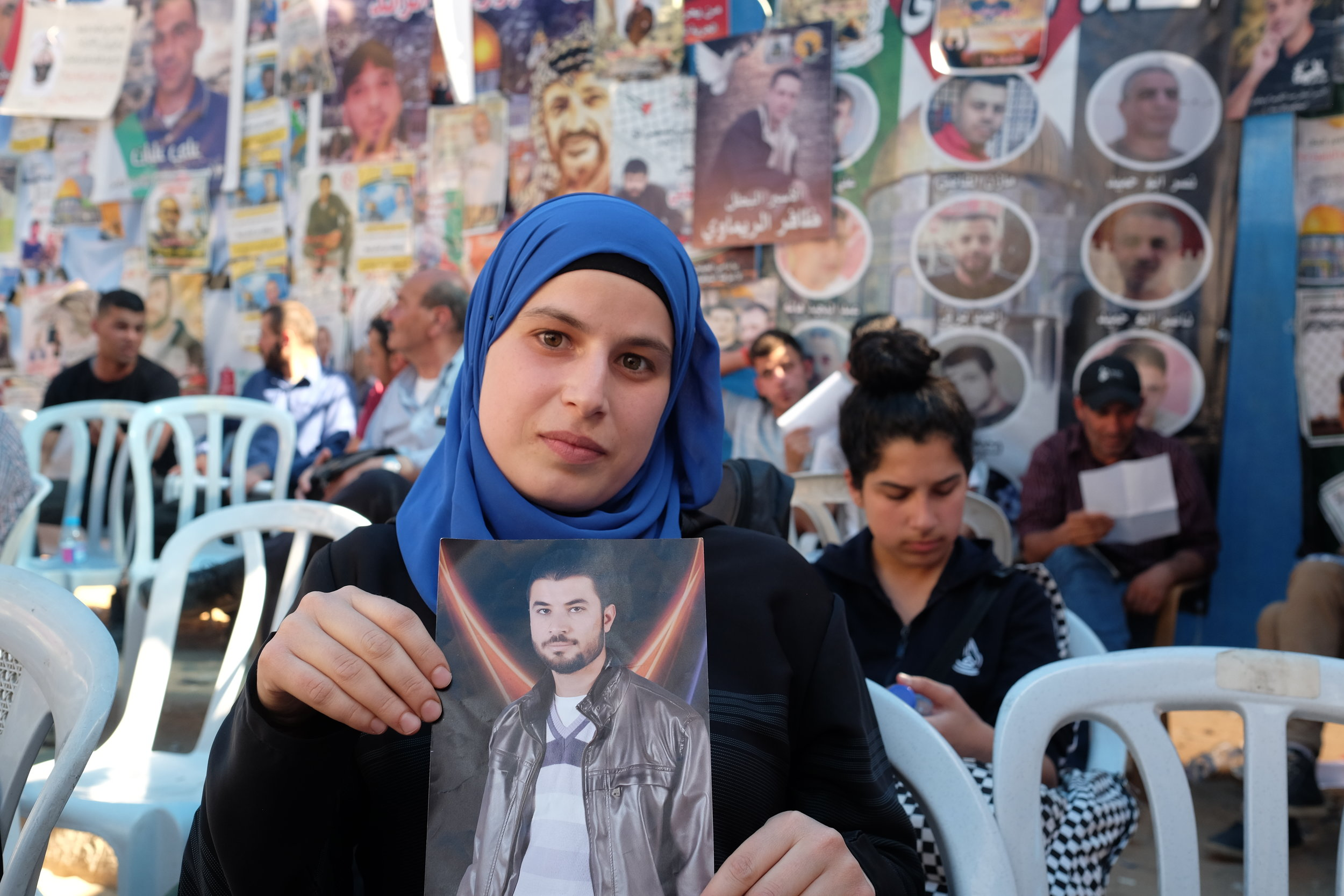 """Haneen,in the Ramallah tent for family members of Palestinian prisoners on hunger strike. """"Everyone I know has a family member in jail or who was killed,"""" she says. Published by Women in the World in association with The New York Times."""