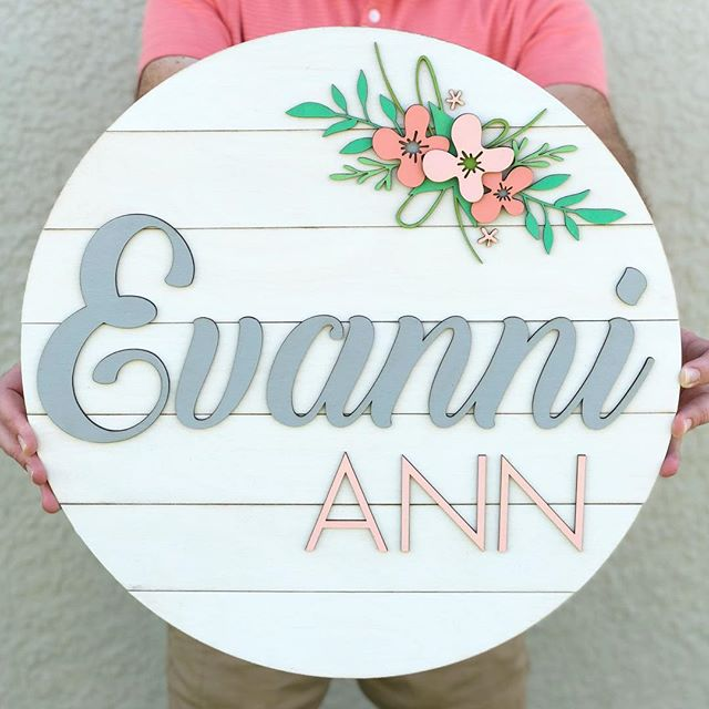 """We often get asked if we do completely custom pieces. The answer is YES! This piece was so much fun to create, and it's gorgeous. 😍 18"""" sign with a shiplap background, custom florals and fonts. I might have to add this style to the shop, what do you think? Check stories for more pics, as well as some other floral ideas I was playing around with! . #shiplap #babynamesign #babynameideas #girlnursery #nurserydecor #floralnursery #shiplapnursery #roundwoodsign #woodsign #woodnamesign #roundwoodnamesign #mamamakers #makersgonnamake #etsymama #wintergardenfl #madeinwintergarden"""